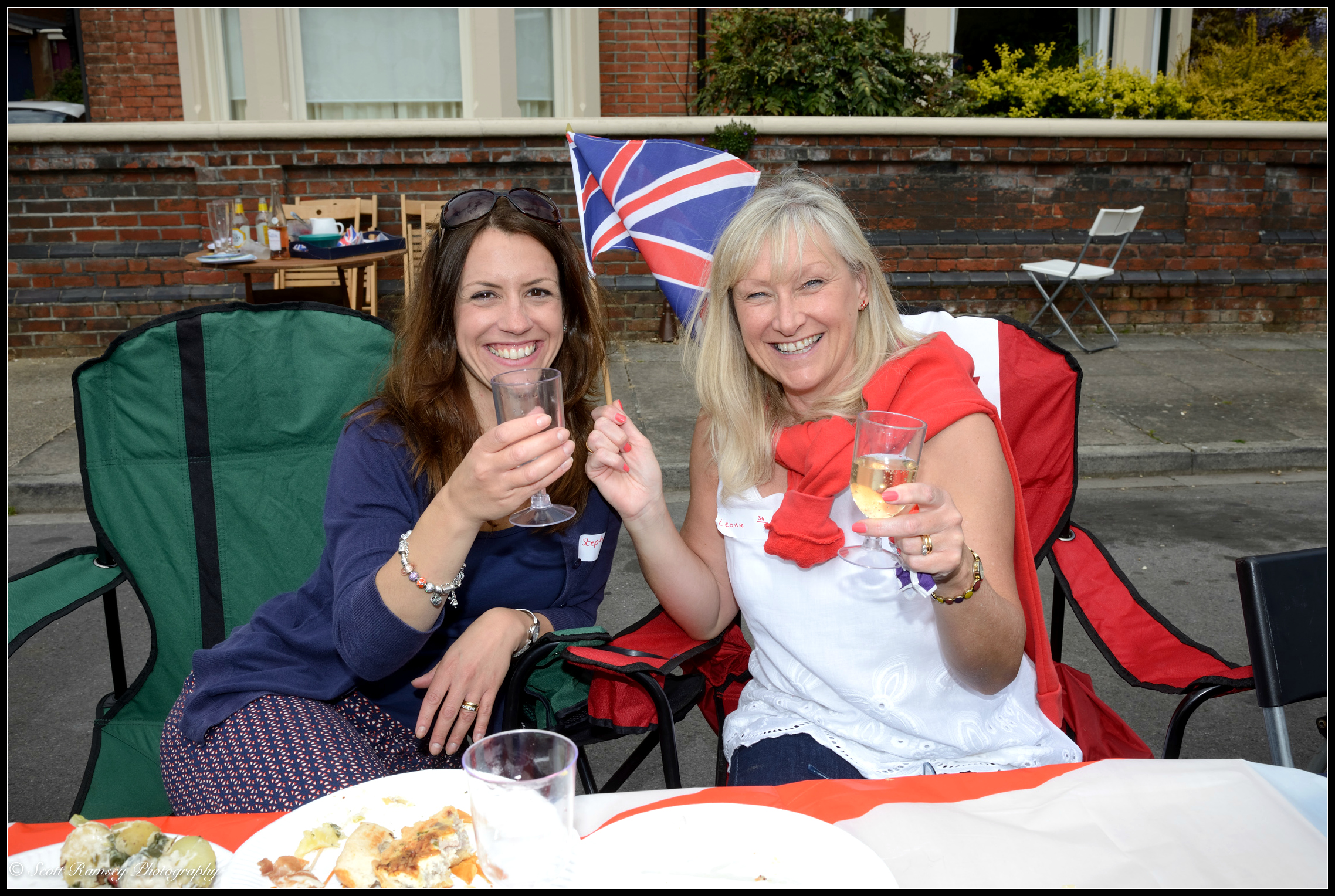 Two of the residents of Nettlecombe Avenue in Southsea enjoy the VE Day 70th anniversary street party. © Scott Ramsey Photography.