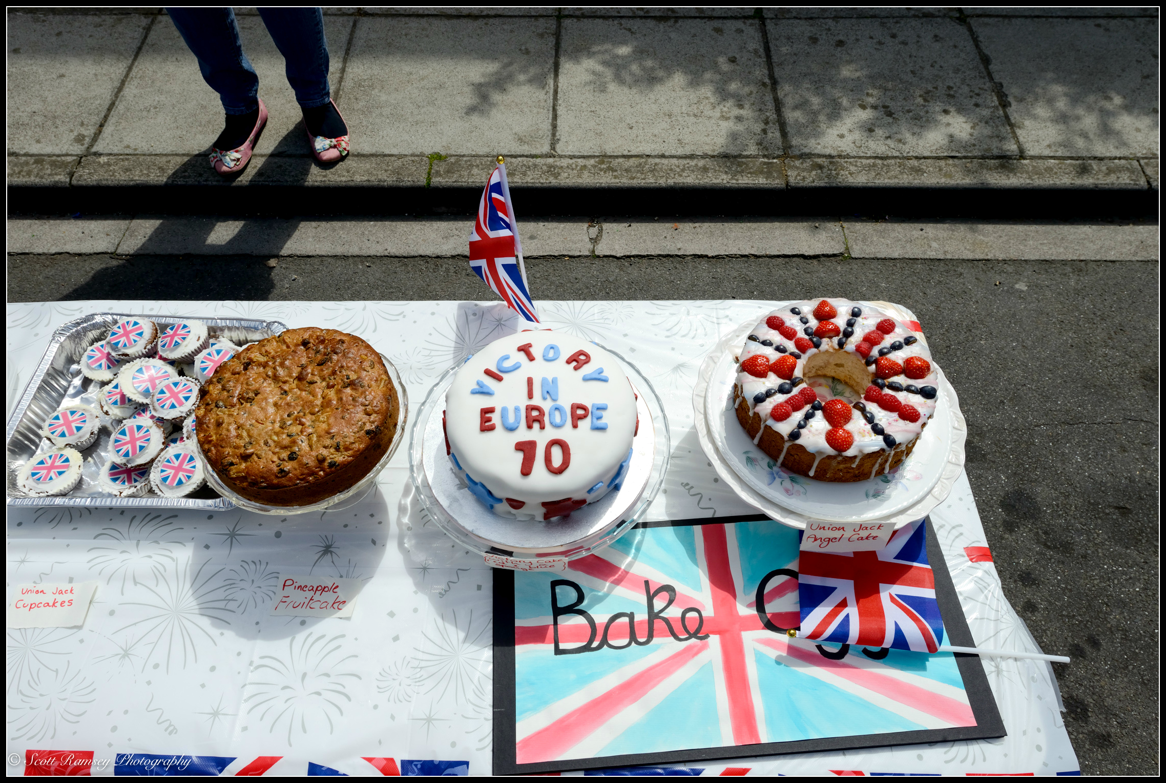 VE Day inspired cakes made by residents of the street sit on a table waiting to be judged in baking competition during the VE Day street party in Southsea, Portsmouth. © Scott Ramsey Photography.
