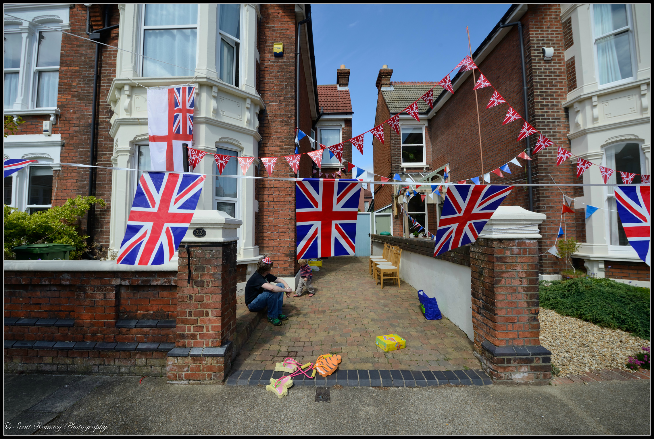 A house in Nettlecombe Avenue, Southsea, Portsmouth, UK is covered in flags and bunting during the VE day 70th anniversary street party celebrations. © Scott Ramsey Photography.