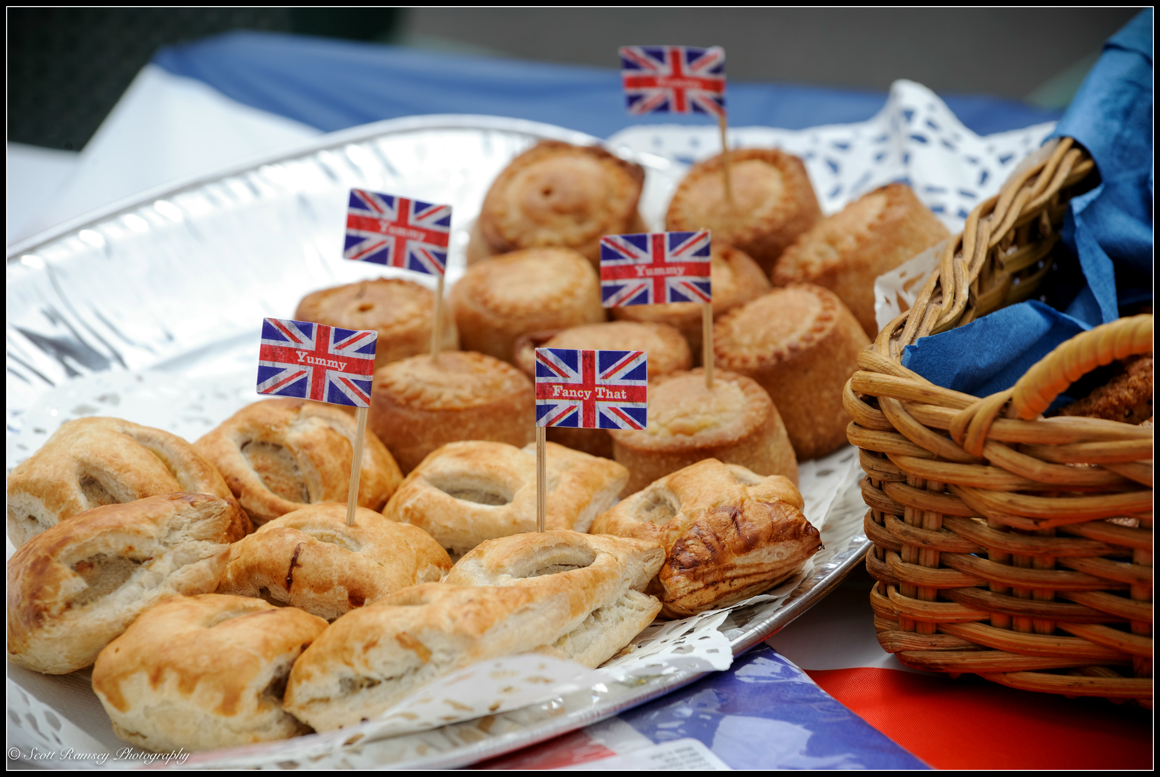 Mini sausage rolls and pork pies with union jack flags stuck into them on a table at theVE day 70th anniversary street party in Southsea, Portsmouth, UK.© Scott Ramsey Photography.