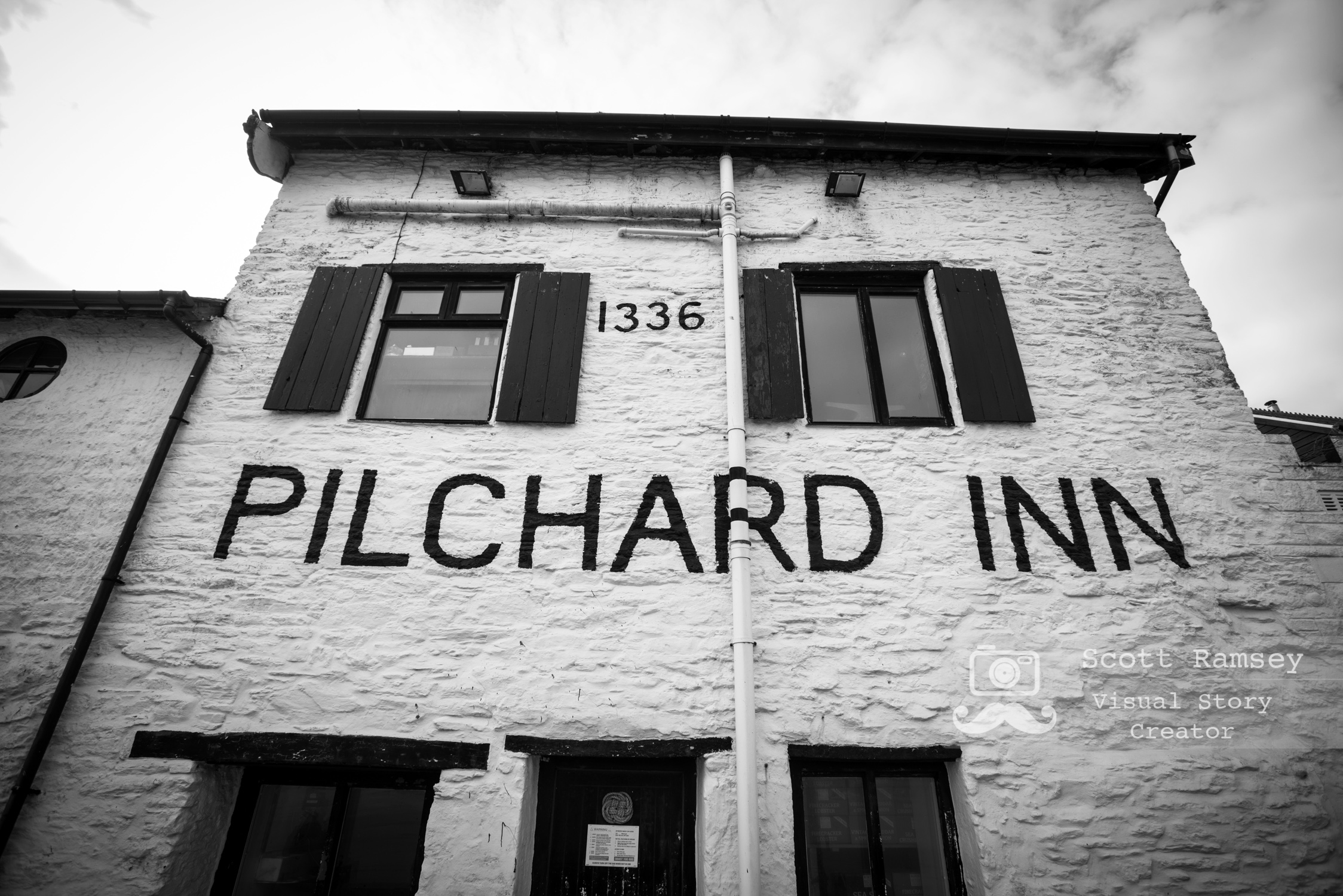 The Pilchard Inn on Burgh Island in Devon, England.  Photo © Scott Ramsey. The inn was built in 1336 and was an ideal place for smugglers to stay hidden from the law. It is small compared to today's standards with only a bar, a roaring fire and few stools inside. If only the walls could talk, just imagine the wonderful stories they could tell.