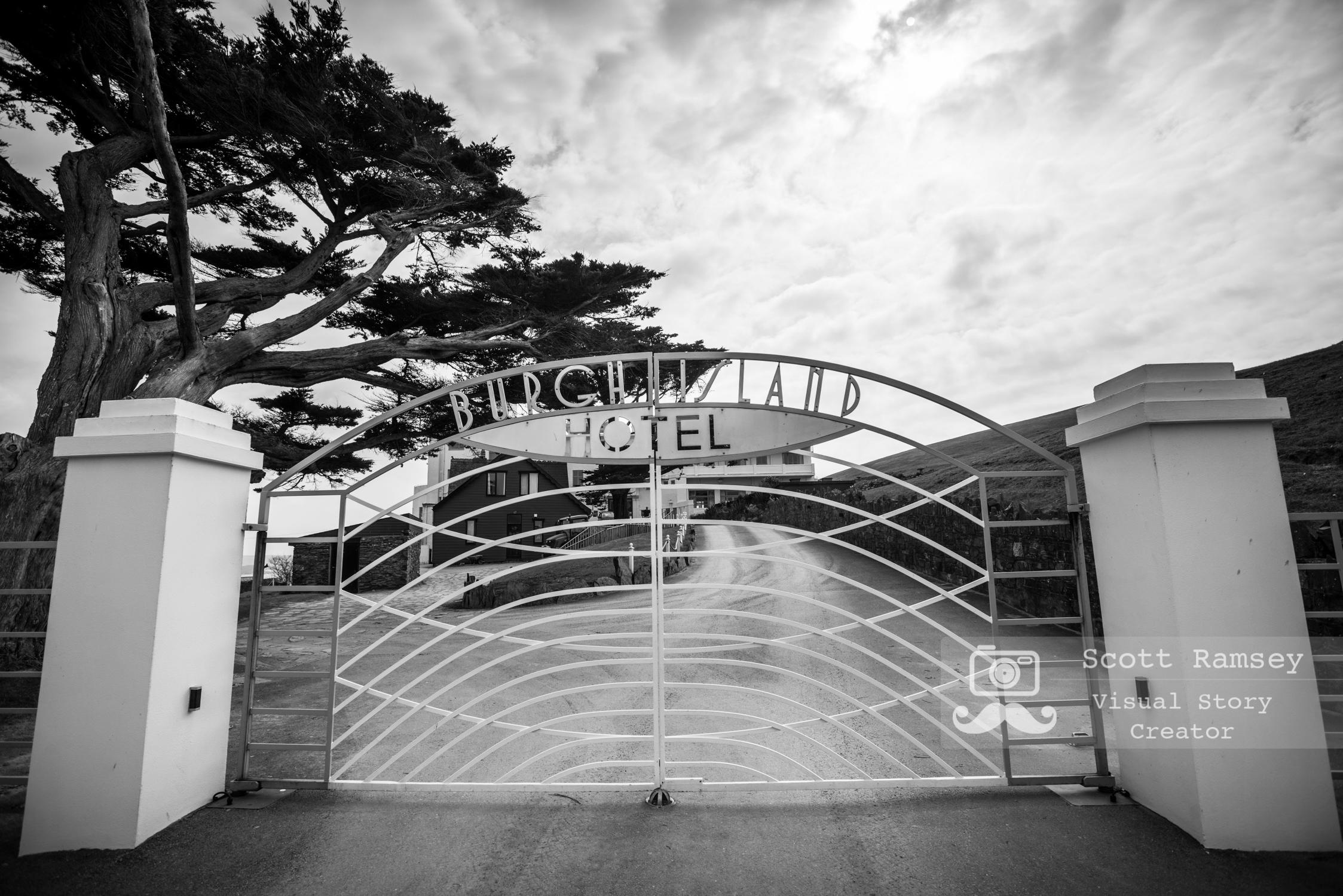 The Gate to the Burgh Island Hotel in Devon, England.  Photo © Scott Ramsey. Originally a wooden house used by guests as a weekend retreat in the 1890s the very popular Art Deco style hotel was built in 1927 by the filmmaker Archibald Nettlefold. Now a Grade II listed building,  Burgh Island Hotel has been visited by such notable guests as Edward VIII and Wallis Simpson,Winston Churchill and The Beatles to name just a few.