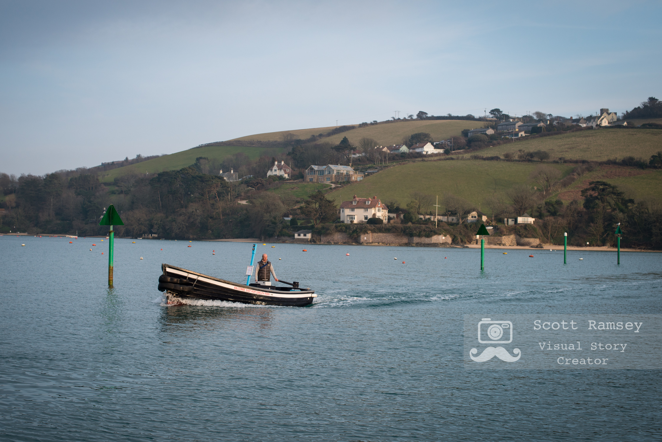 As the evening light starts to fade the East Portlemouth Ferry crosses the estuary on it's journey back to the harbour in Salcombe. Photo © Scott Ramsey