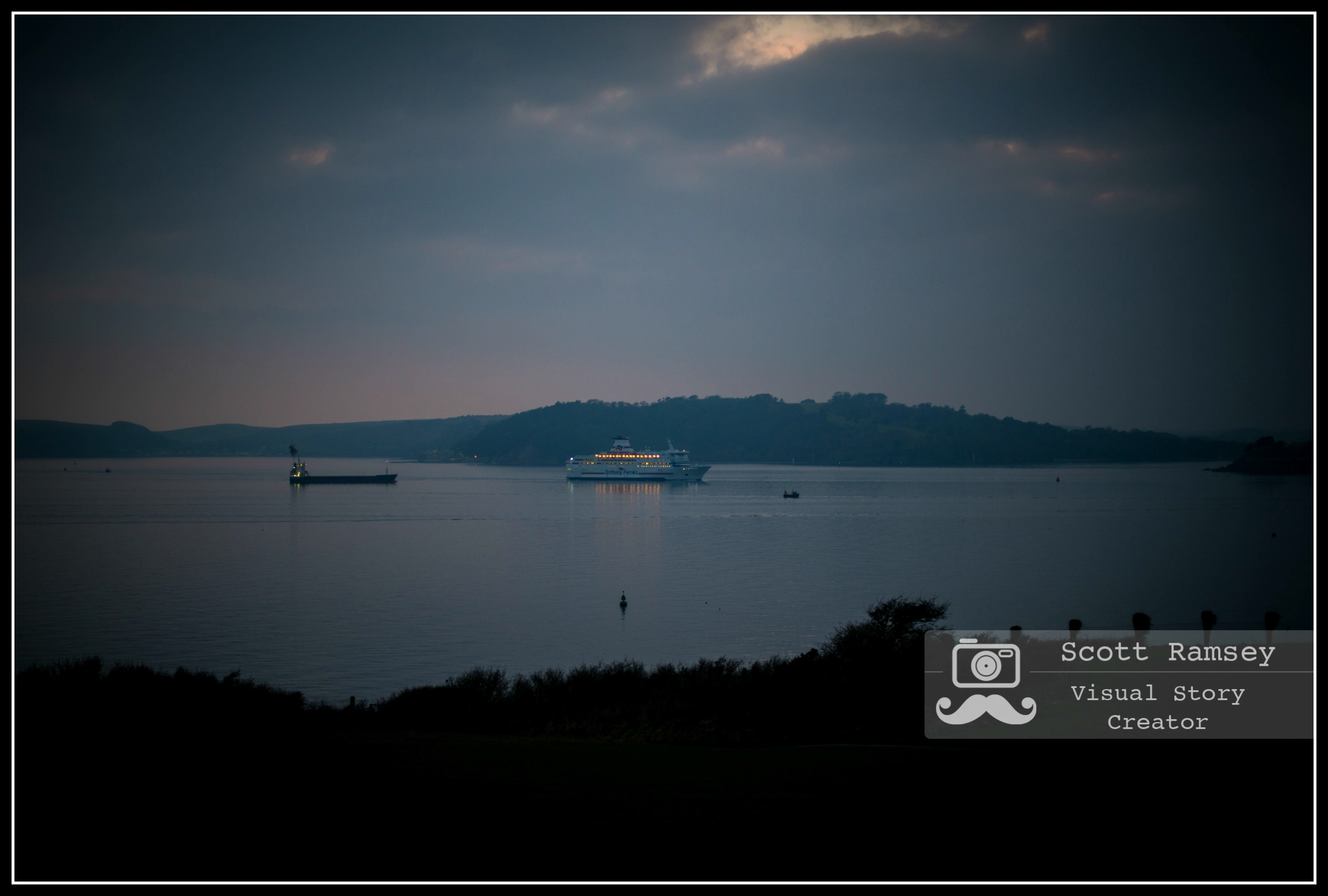 During nightfall a ferry arrives into Plymouth Sound in Devon. Photo © Scott Ramsey.
