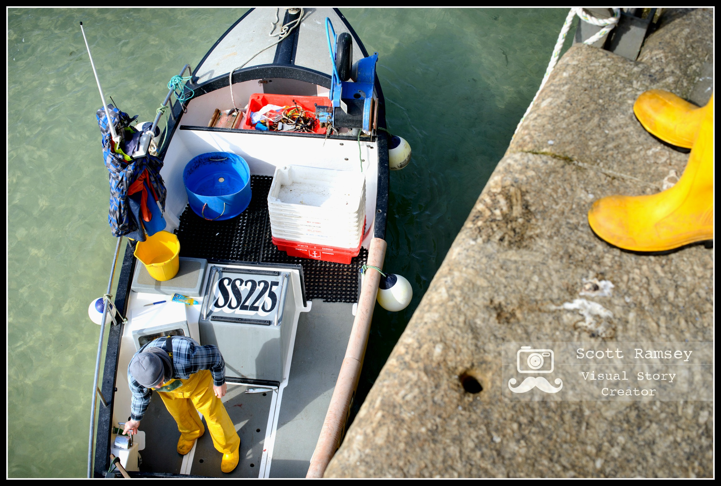 Travel Photography Cornwall - A fisherman prepares his fishing boat before heading out to sea for a day of fishing at the harbour in St Ives, Cornwall, UK. Photo © Scott Ramsey