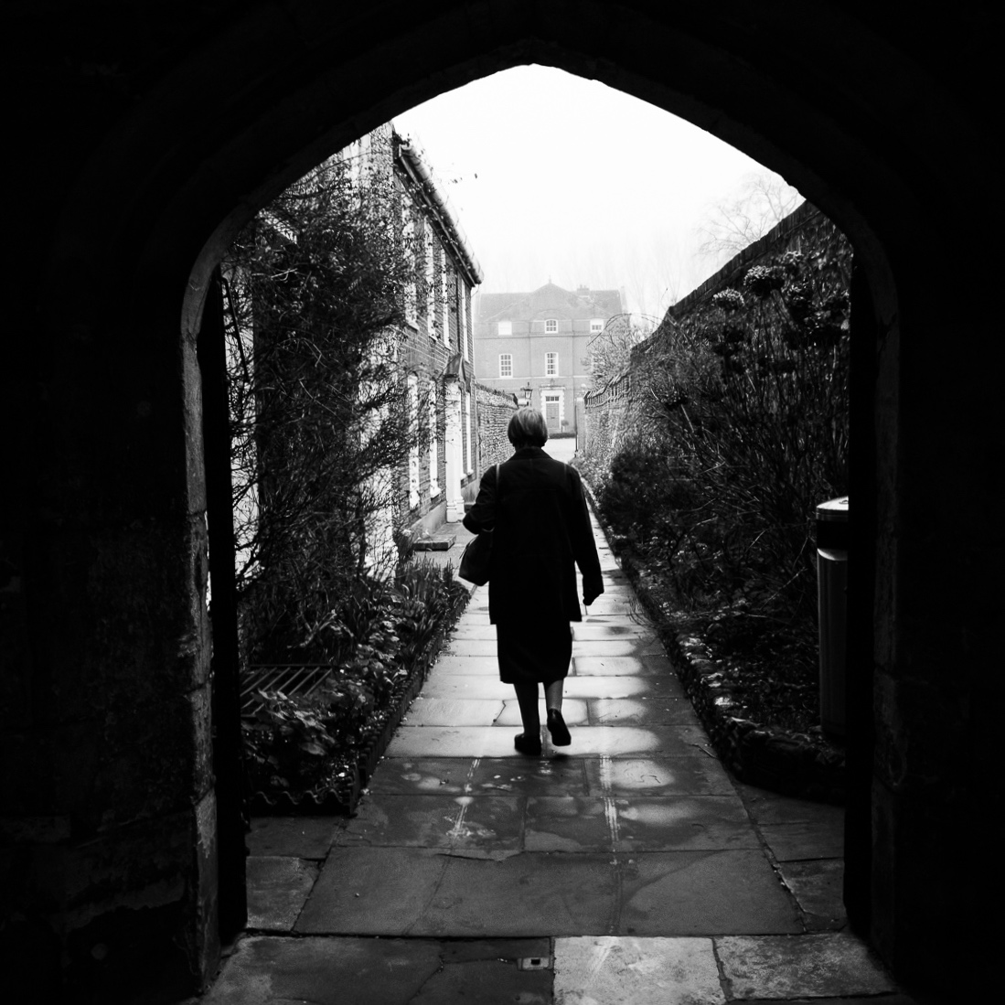 I love exploring Chichester with my camera, I took this photo of a lady just after she had walked through a stone archway in the Cloisters of Chichester Cathedral. Photo © Scott Ramsey.