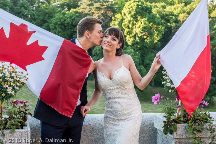 You can see the red reflections from the flags on the bride's dress