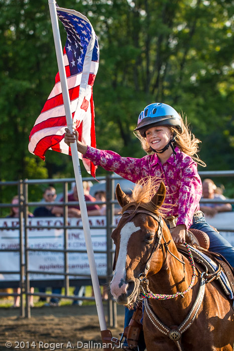 Big. rodeo smile on our flag girl