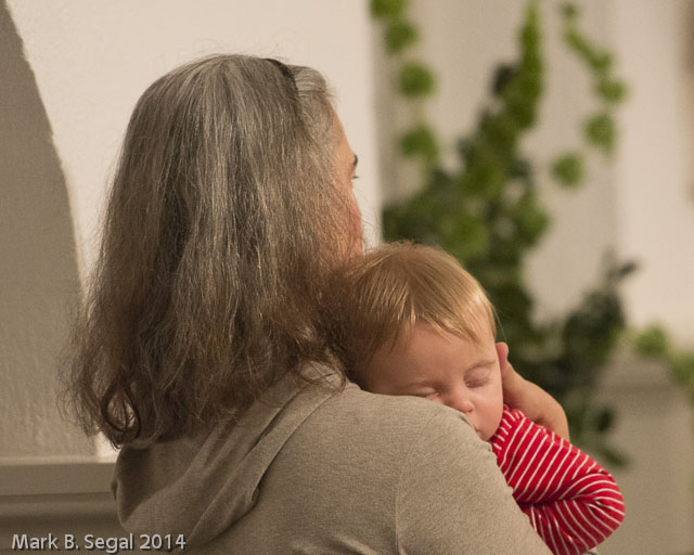 Aperture priority to make the background soft as this baby enjoyed the Christmas concert