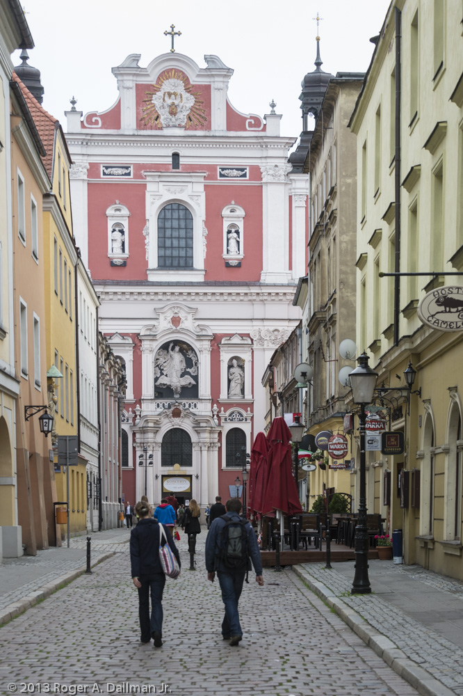 A basilica, at the end of a Poznan, Poland, street