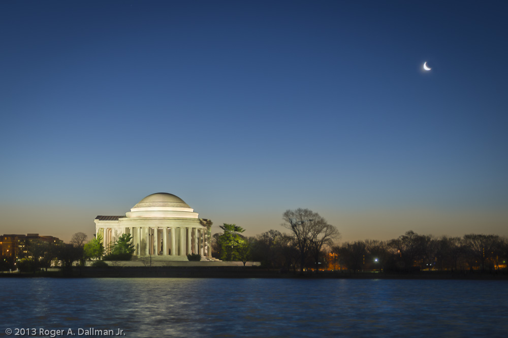 The Jefferson Memorial, with a crescent moon
