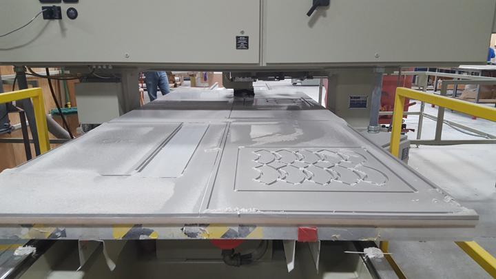 Side by side sheets of corian on a CNC router bed.