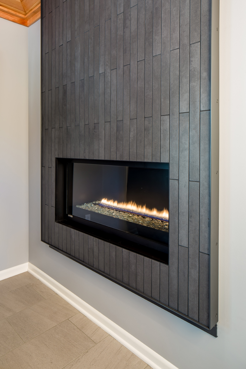 Custom steel framing around the fireplace