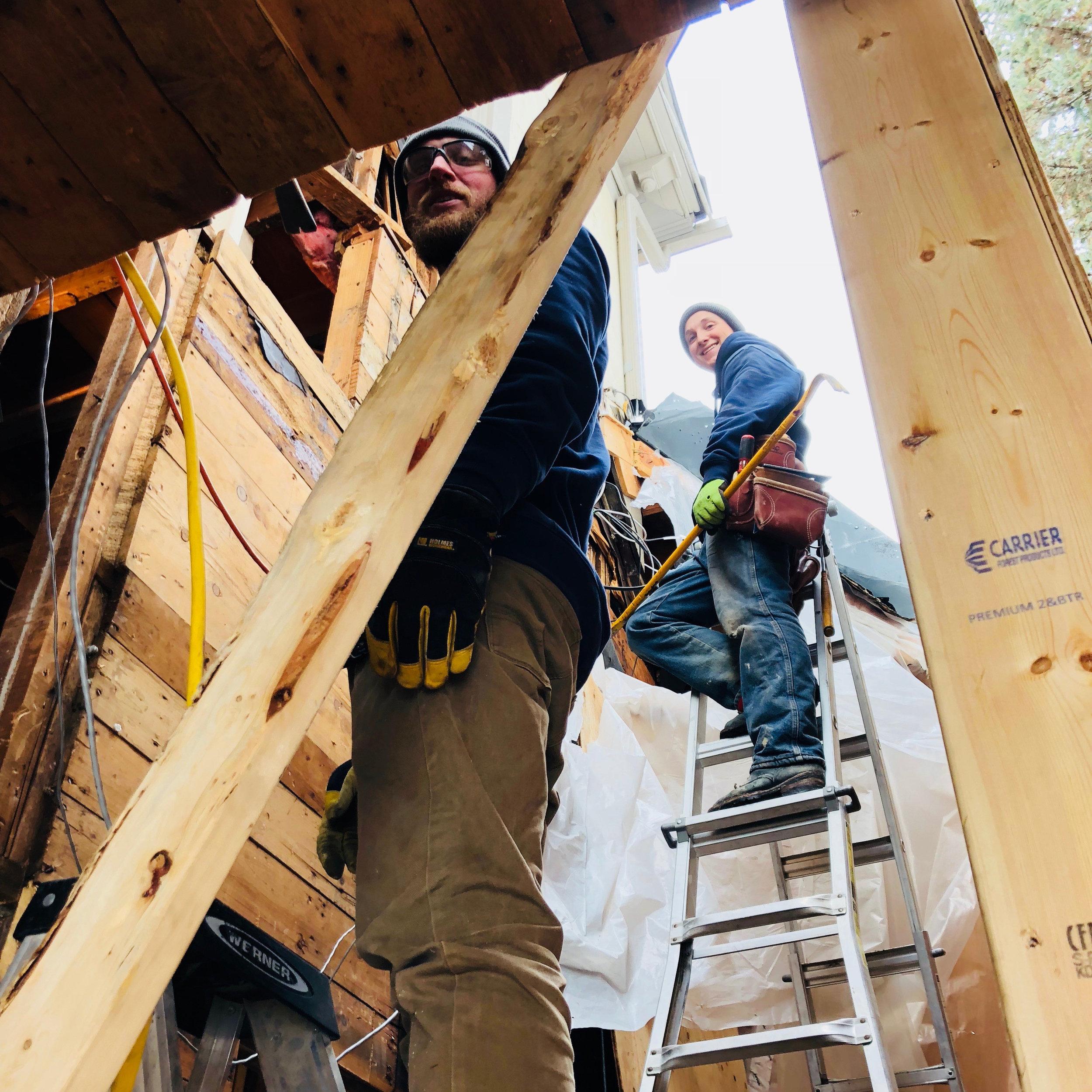 Carpenters on ladders