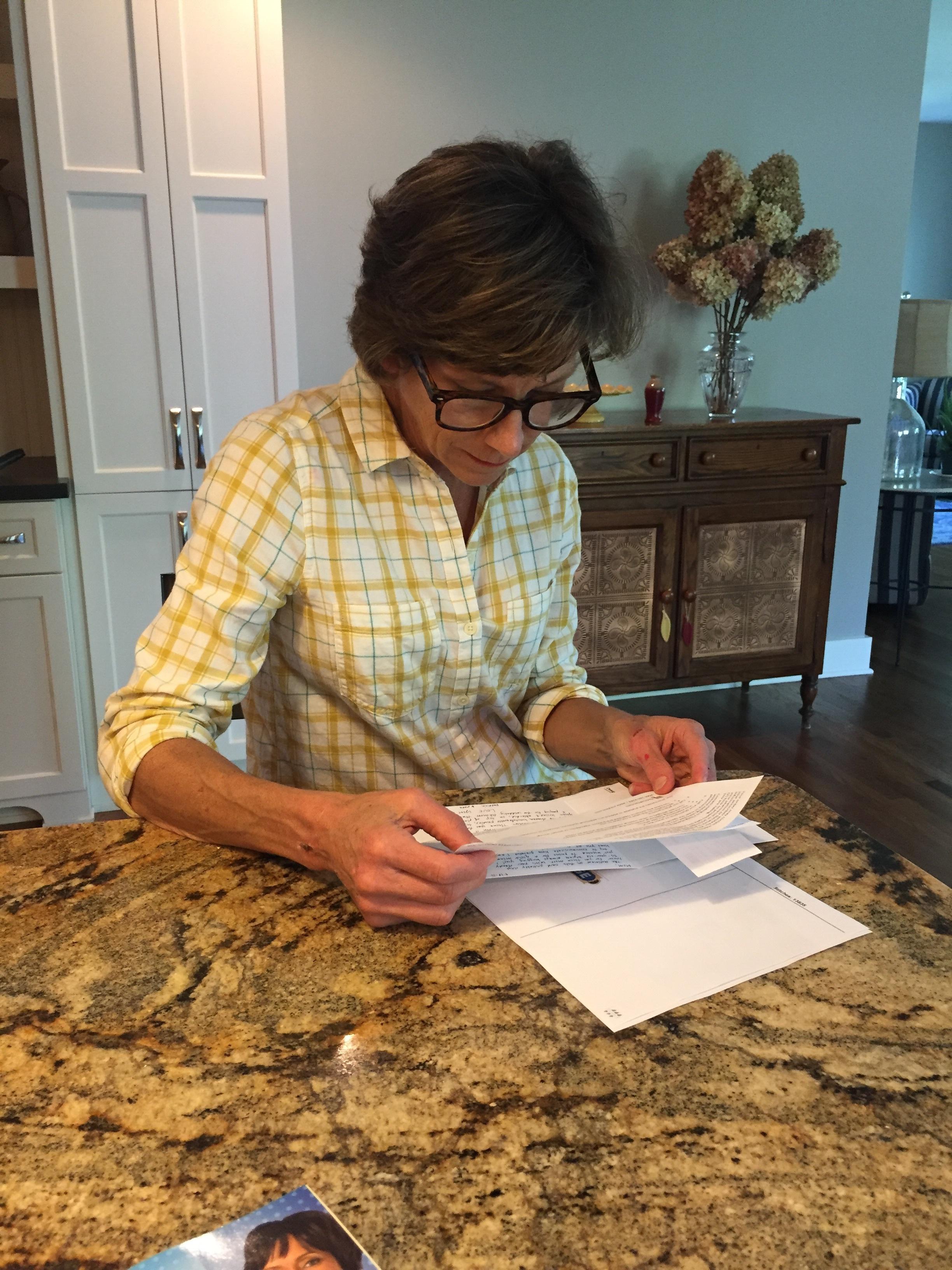 Diane Niehaus (above) checks Lee, Chia Hua's extensive resume.
