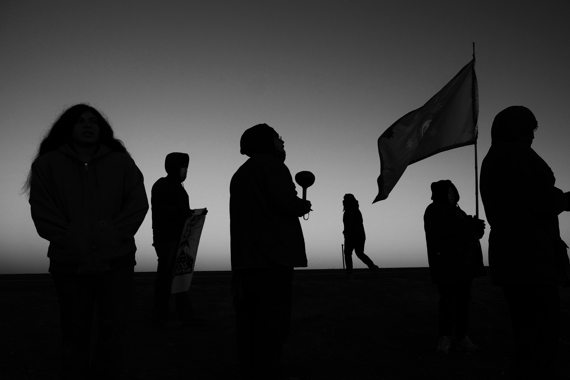 Members of Sociey of Native Nations and Big Bend citizens gather in the morning light near the border of Mexico to protest the Trans-Pecos Pipeline running across the Rio Grande.