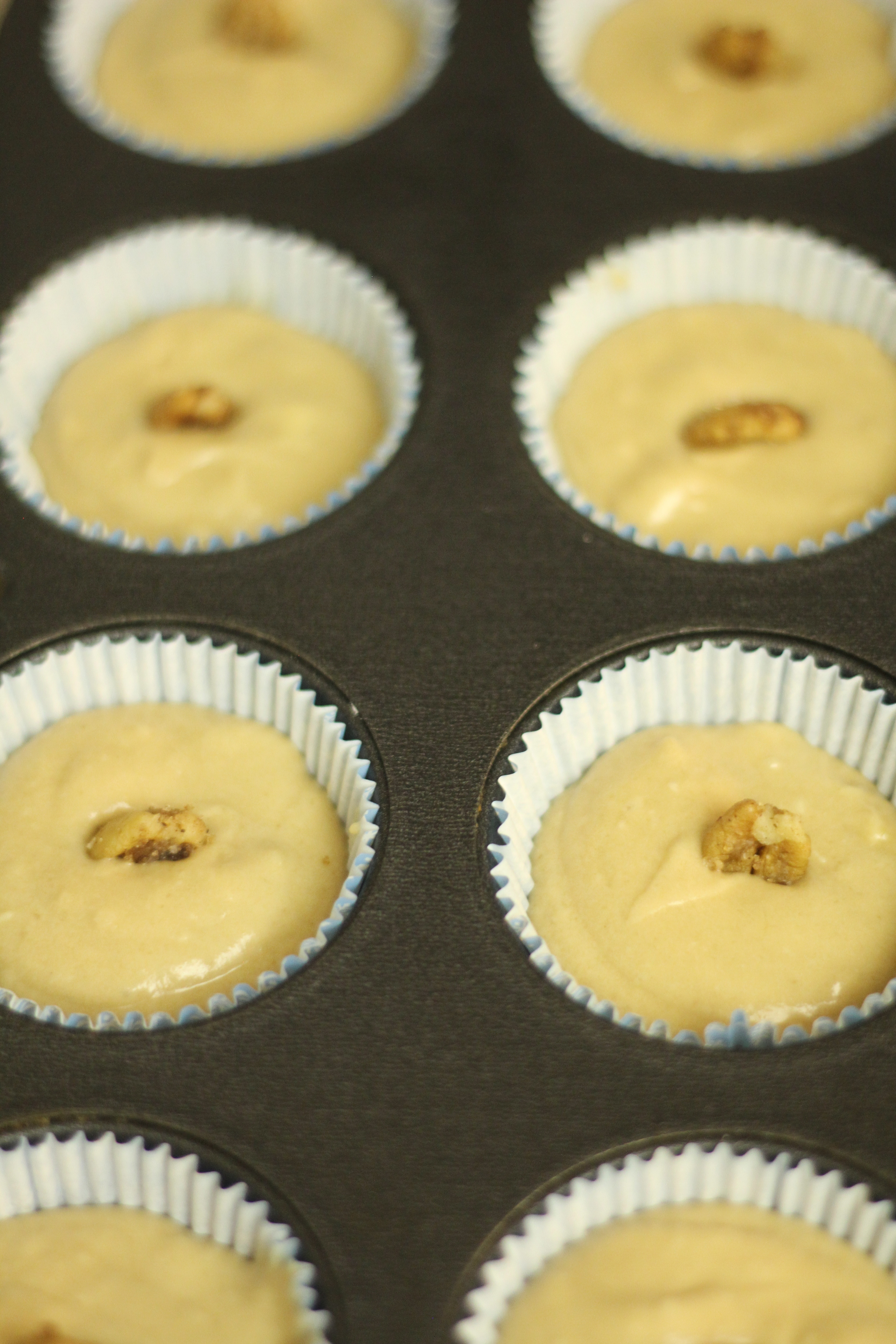 Pre-baked cupcakes with candied pecans.