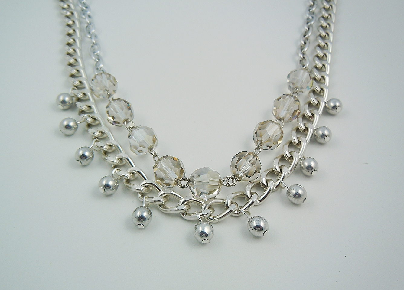 An all silver necklace that is sure to get noticed even with the most basic outfit. Made of Swarovski crystals and Czech glass beads