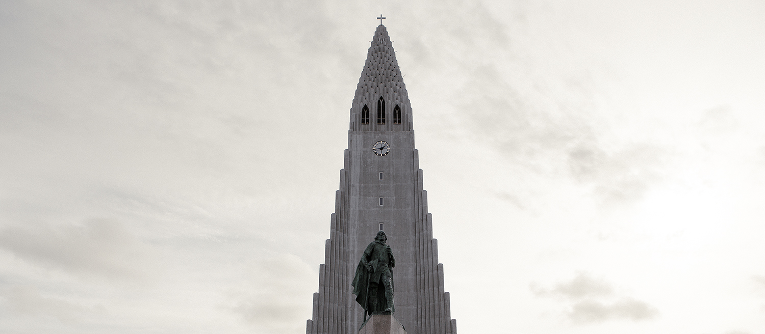 The churchHallgrimskirkja towering it's clean and modern simplicity over Reykjavik. In front: Leif Eriksson, explorer who is believed to be the first European to set foot in North America around year 1000 AD.