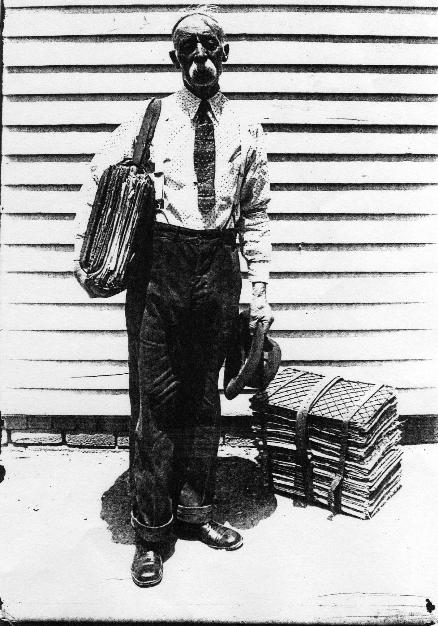 Benjamin F. Bush Sr., taken by J.A. Southern from Examiner about 1930 on south wall of his residence/general store/post office in Courtney, MO.