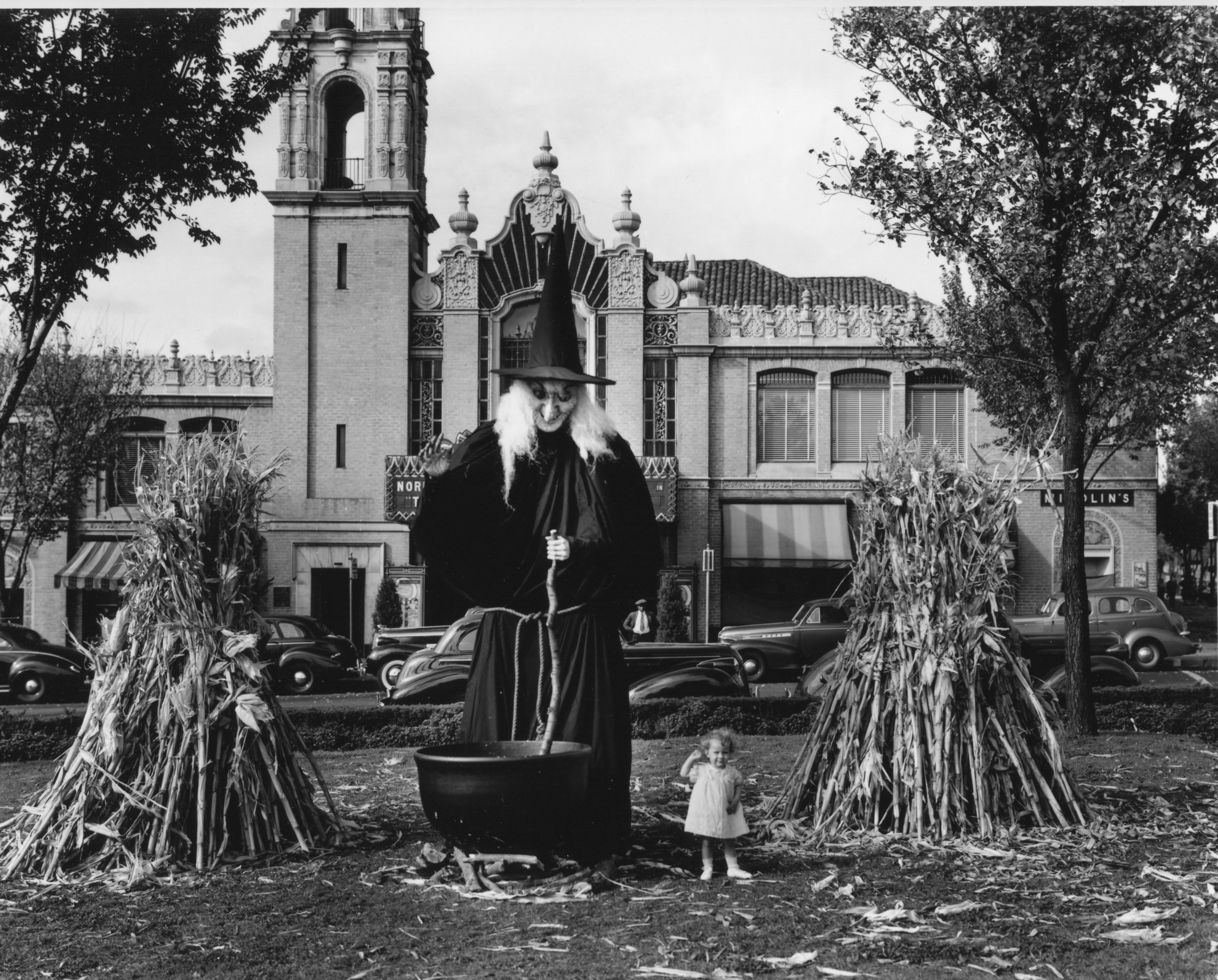Wilborn Collection  Halloween witch on C. C. Plaza in front of Plaza Theatre October 1939 10119-12870.jpg