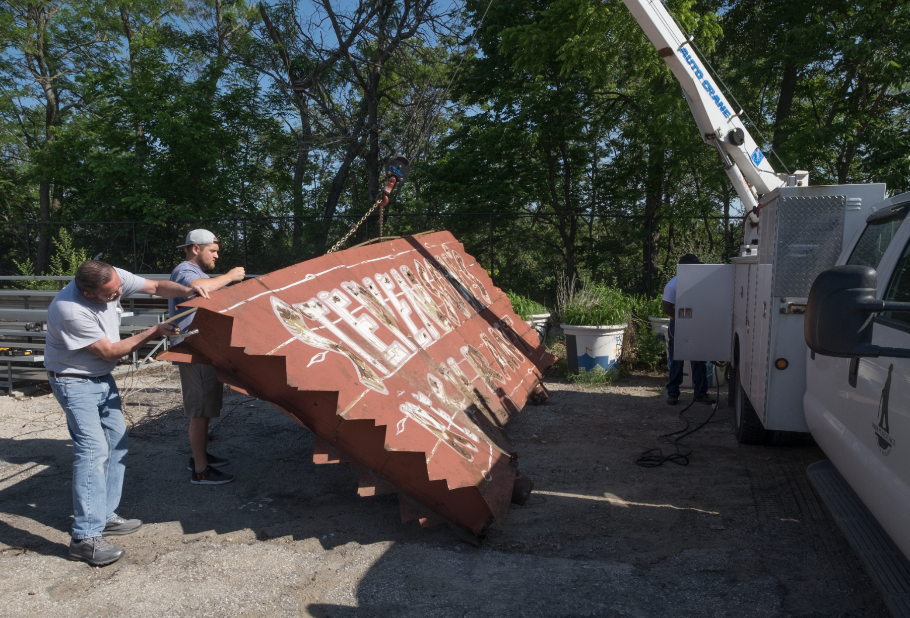 The Stephenson restaurant sign being picked up in Independence in May 2018 by folks involved with The Lumi Museum.