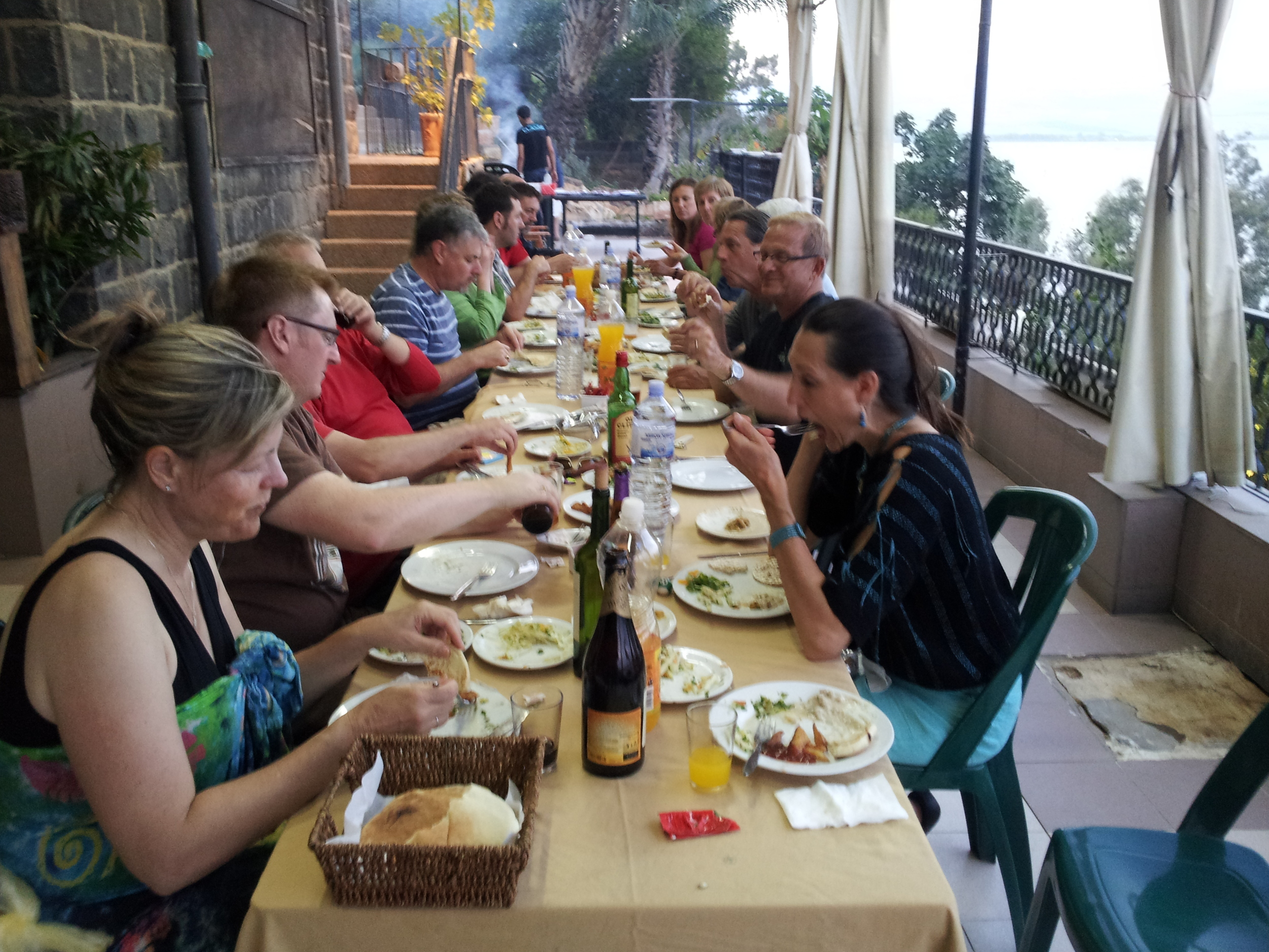 Eating on the veranda overlooking the Sea of Galilee