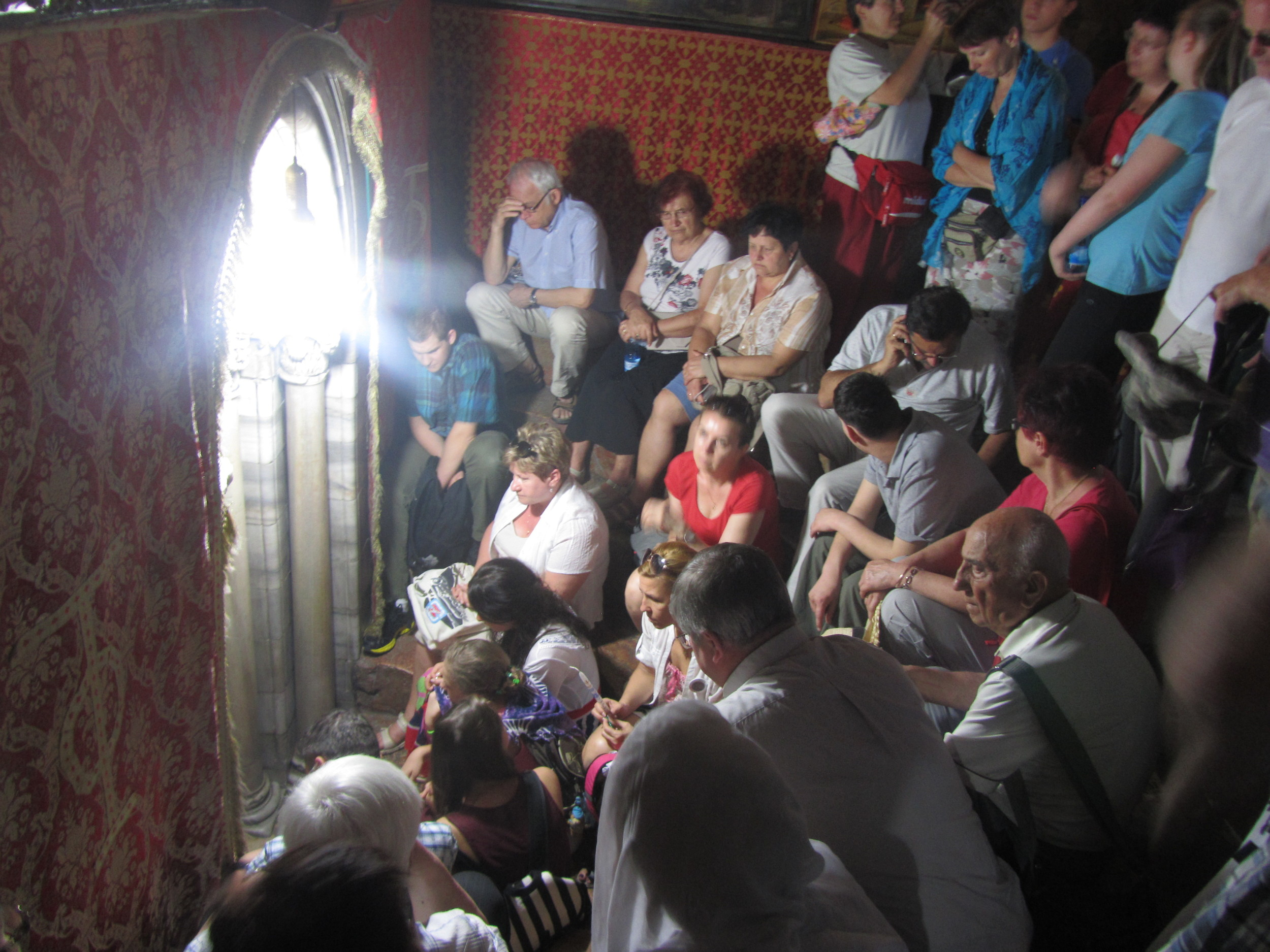 Pilgrims patiently waiting to enter the cave of Jesus' birthplace in Bethlehem