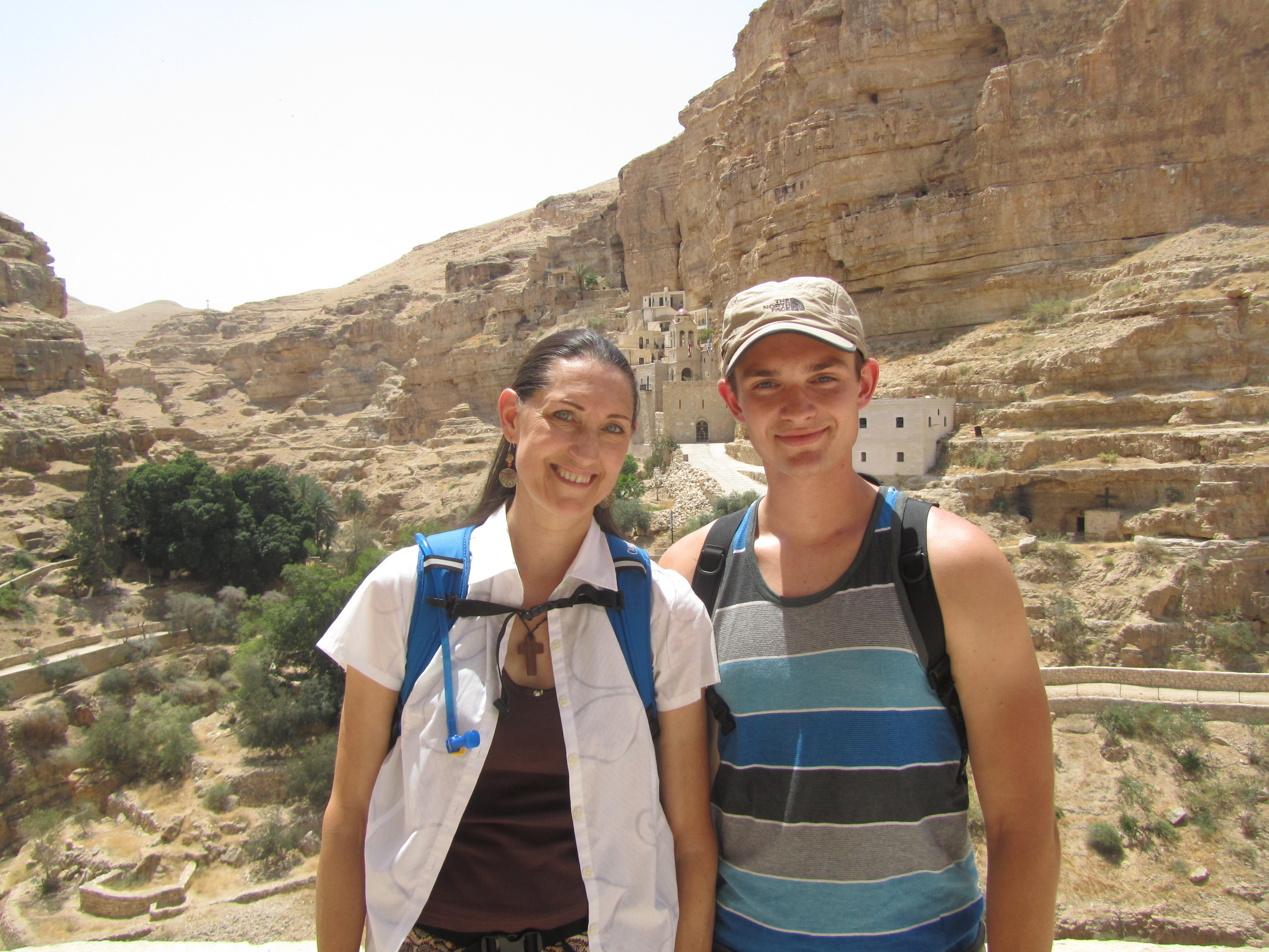 Pam and Luke in Wadi Kelt with St. George's Monastery in the background