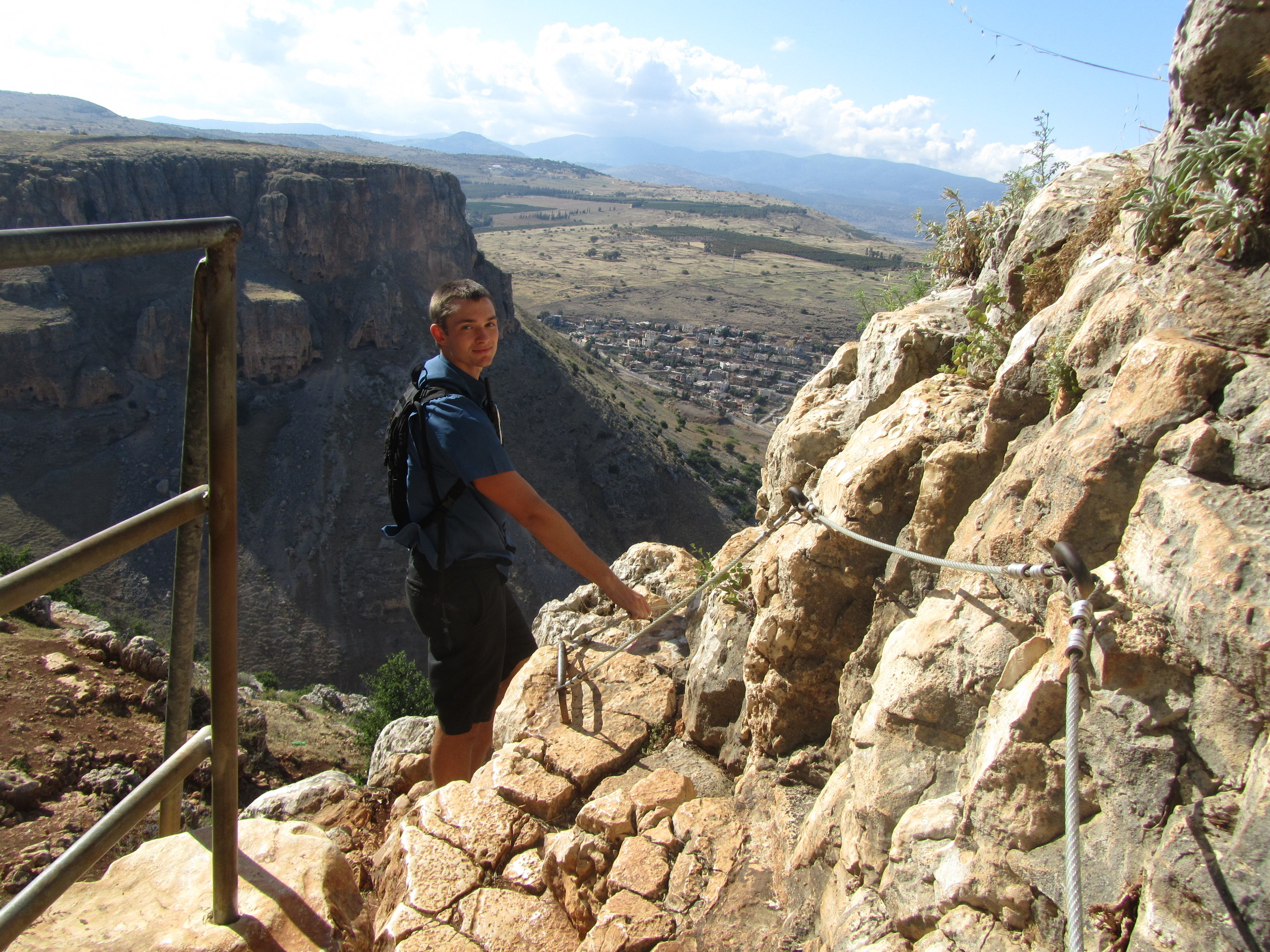 Luke climbing the Cliffs of Arbel to the ancient caves