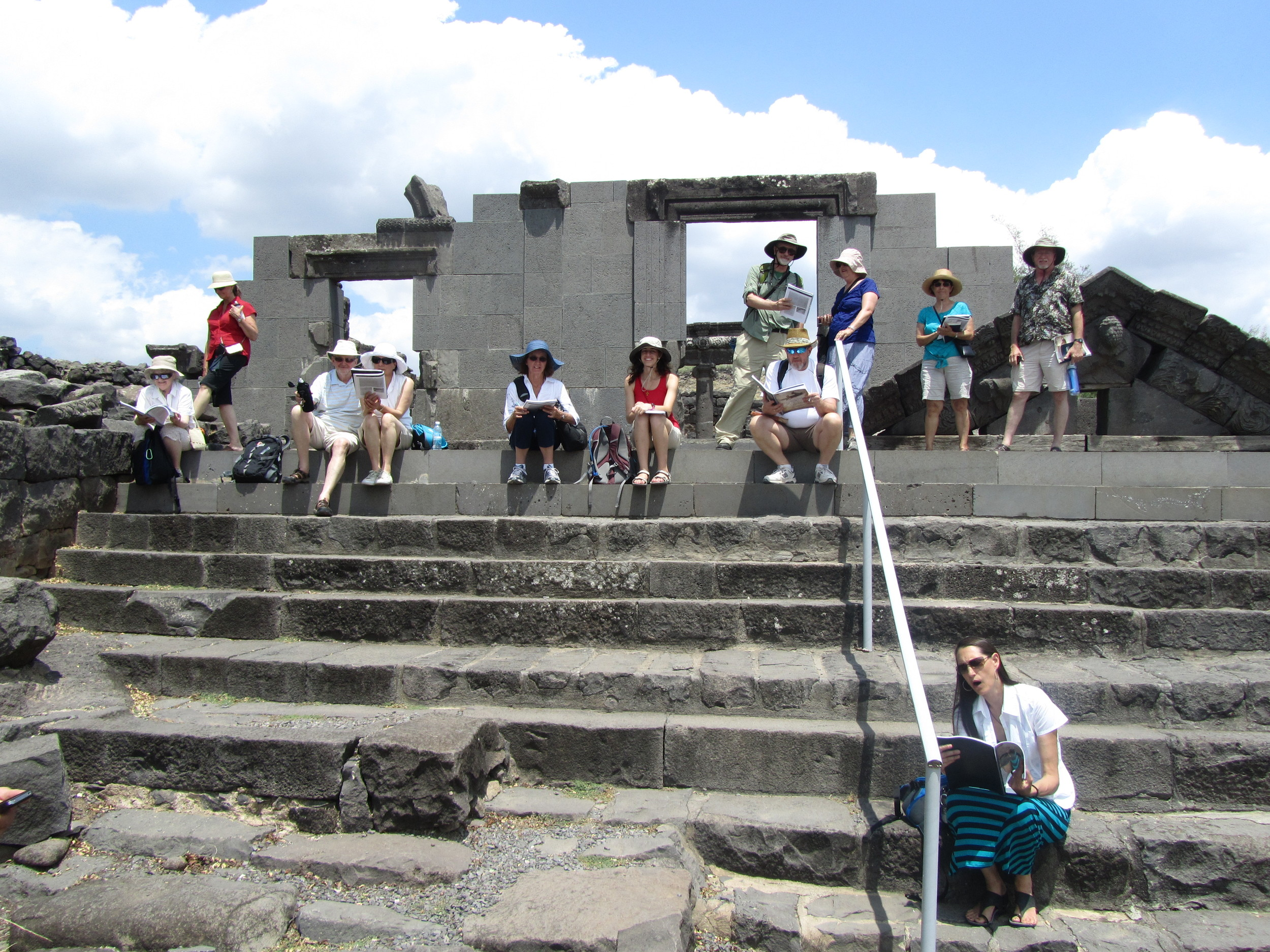 Our group sitting on the front steps of the ancient synagogue of Chorazin