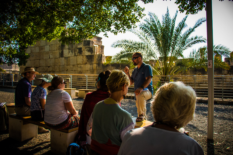Sitting outside the beautiful white limestone synagogue in Capernaum we could see the foundations of the first-century black basalt stonesynagogue in which Jesus taught and cast out demons with authority.