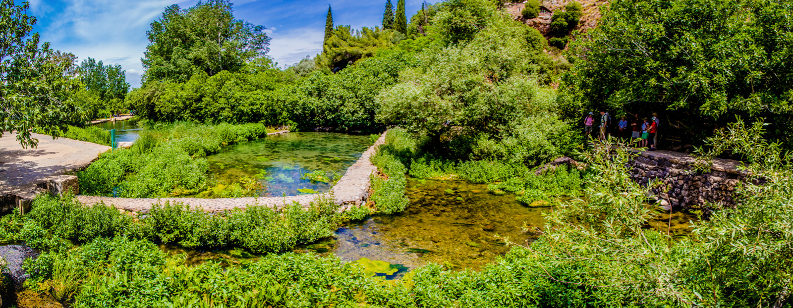 The clear, cold, flowing waters of the Banias Spring comprise the source of the Jordan River and create a lush garden in an otherwise arid climate.