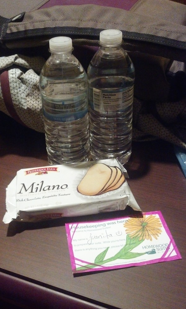 Complimentary bottles of water, complimentary bag of cookies, note from Juanita from Housekeeping.