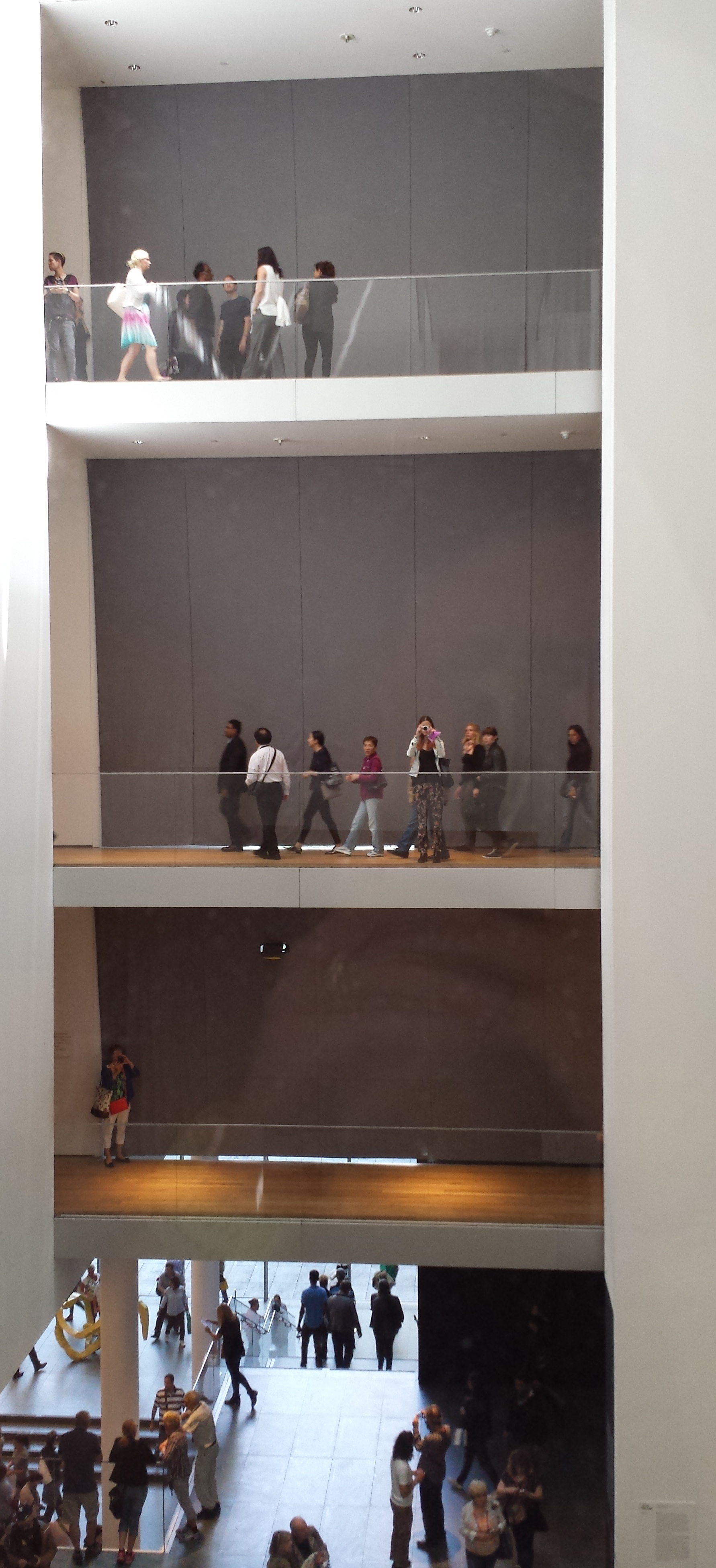 A woman on the same level at the MoMA takes my photo as I take hers. We don't know each other, but here we are locked into each other's photos for ALL TIME.