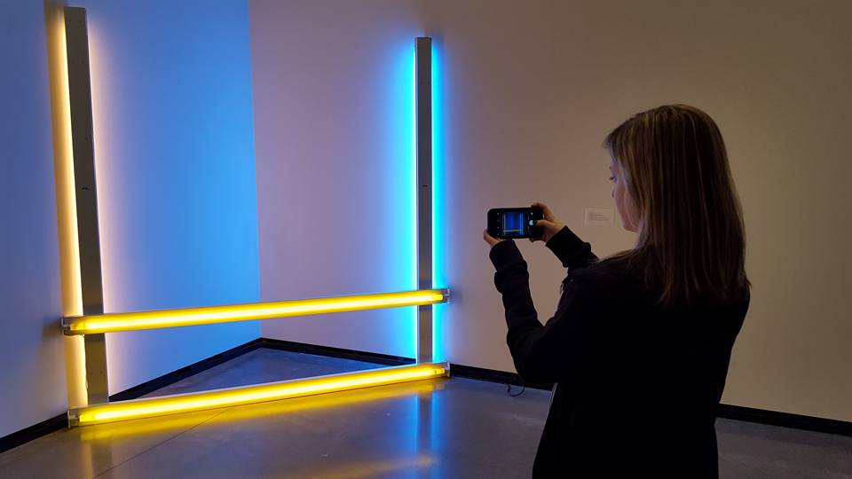 "Daughter taking a photo of ""Untitled (To Donna) II"" by Dan Flavin."