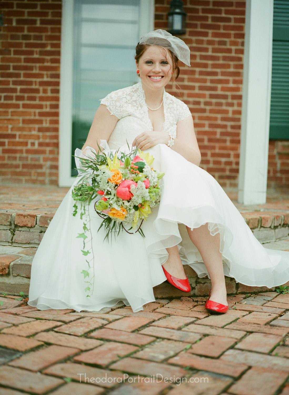 beautiful bride in vintage inspired tea length wedding dress     www.TheodoraPortraitDesign.com   film wedding photography