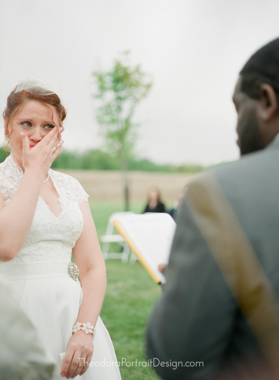 bride and groom exchanging vows   www.TheodoraPortraitDesign.com   film wedding photography