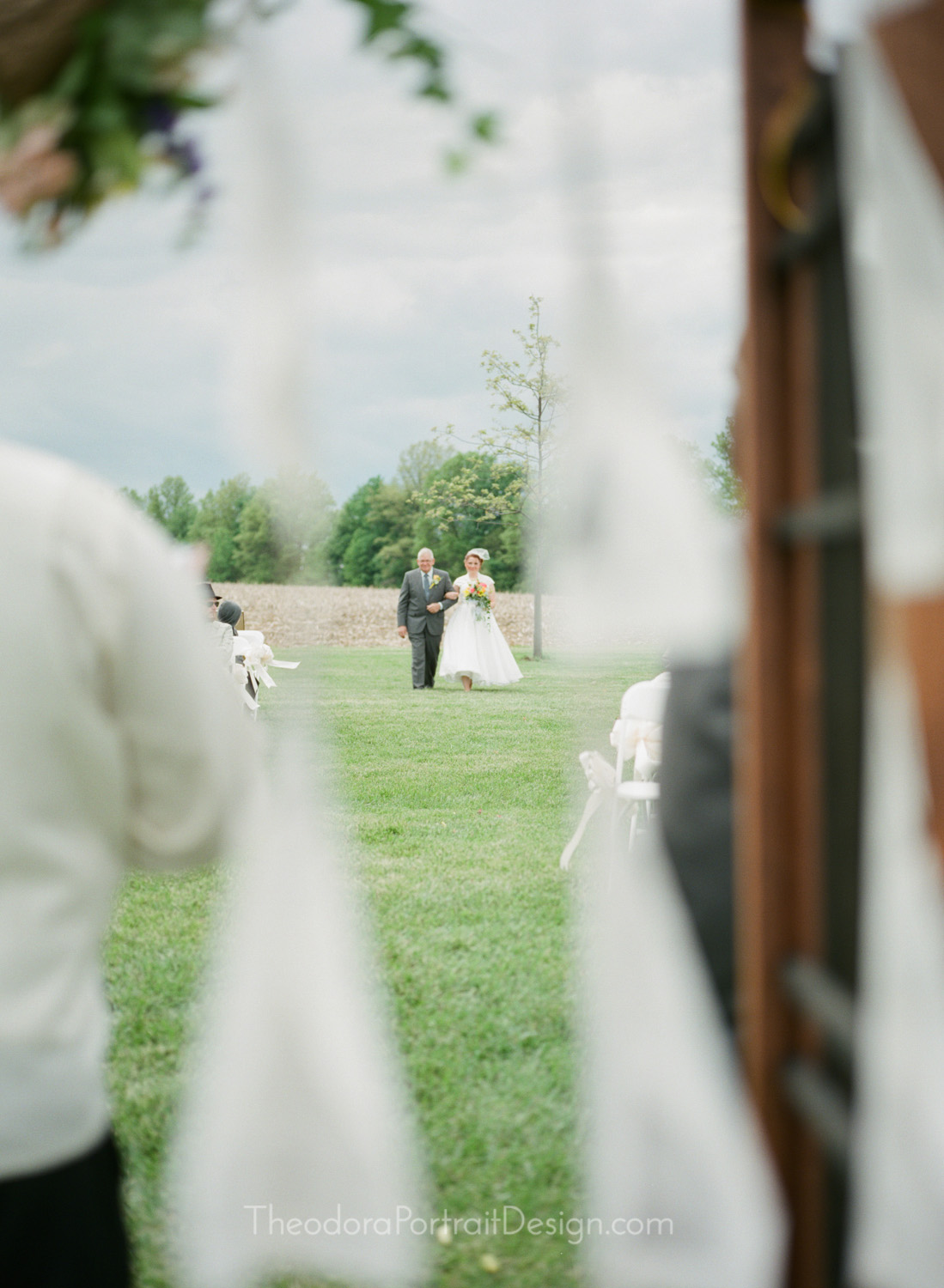father and daughter walking down the aisle     www.TheodoraPortraitDesign.com   film wedding photography