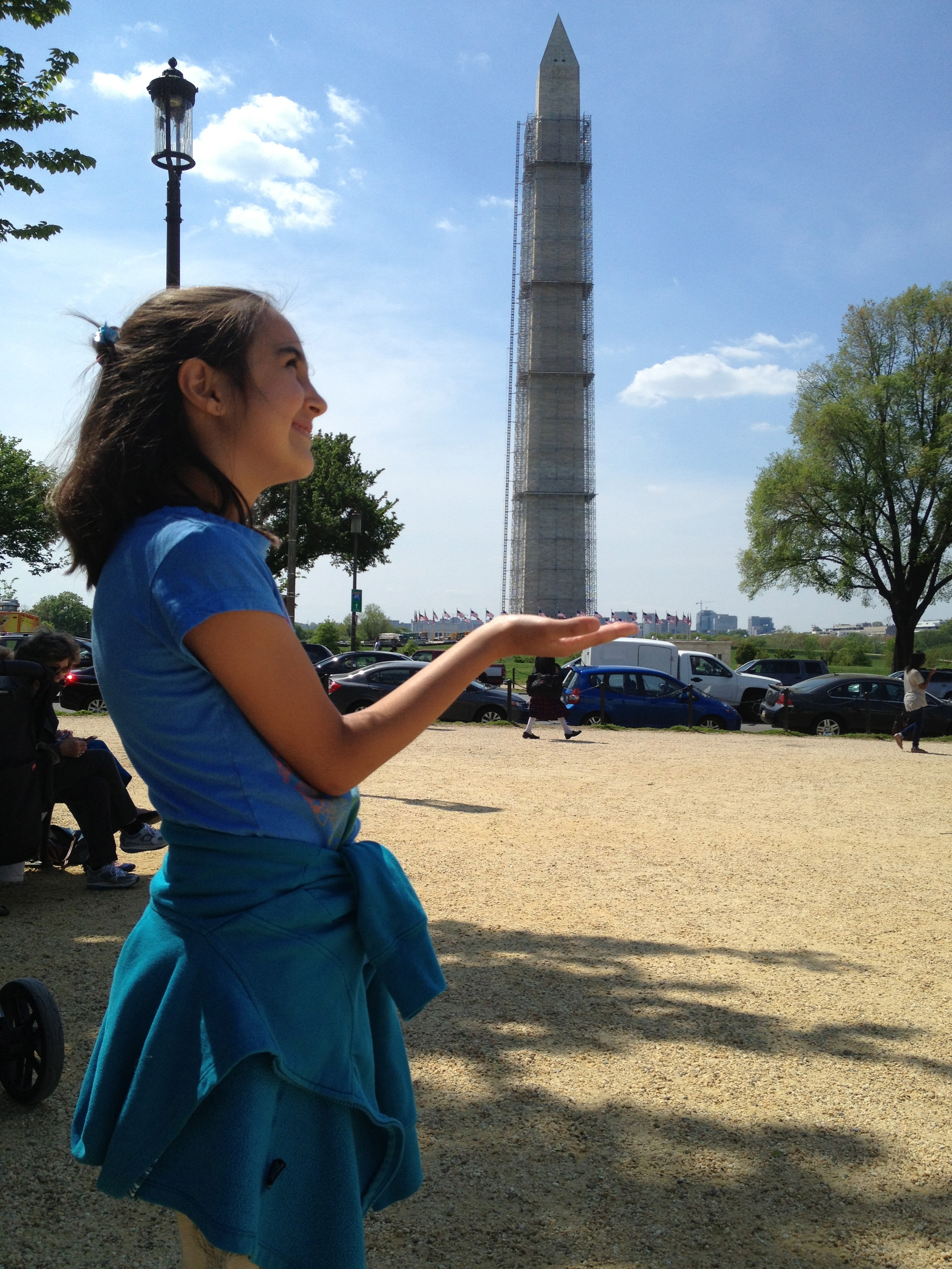 Zoe is strong enough to hold the Washington Monument in her hands.