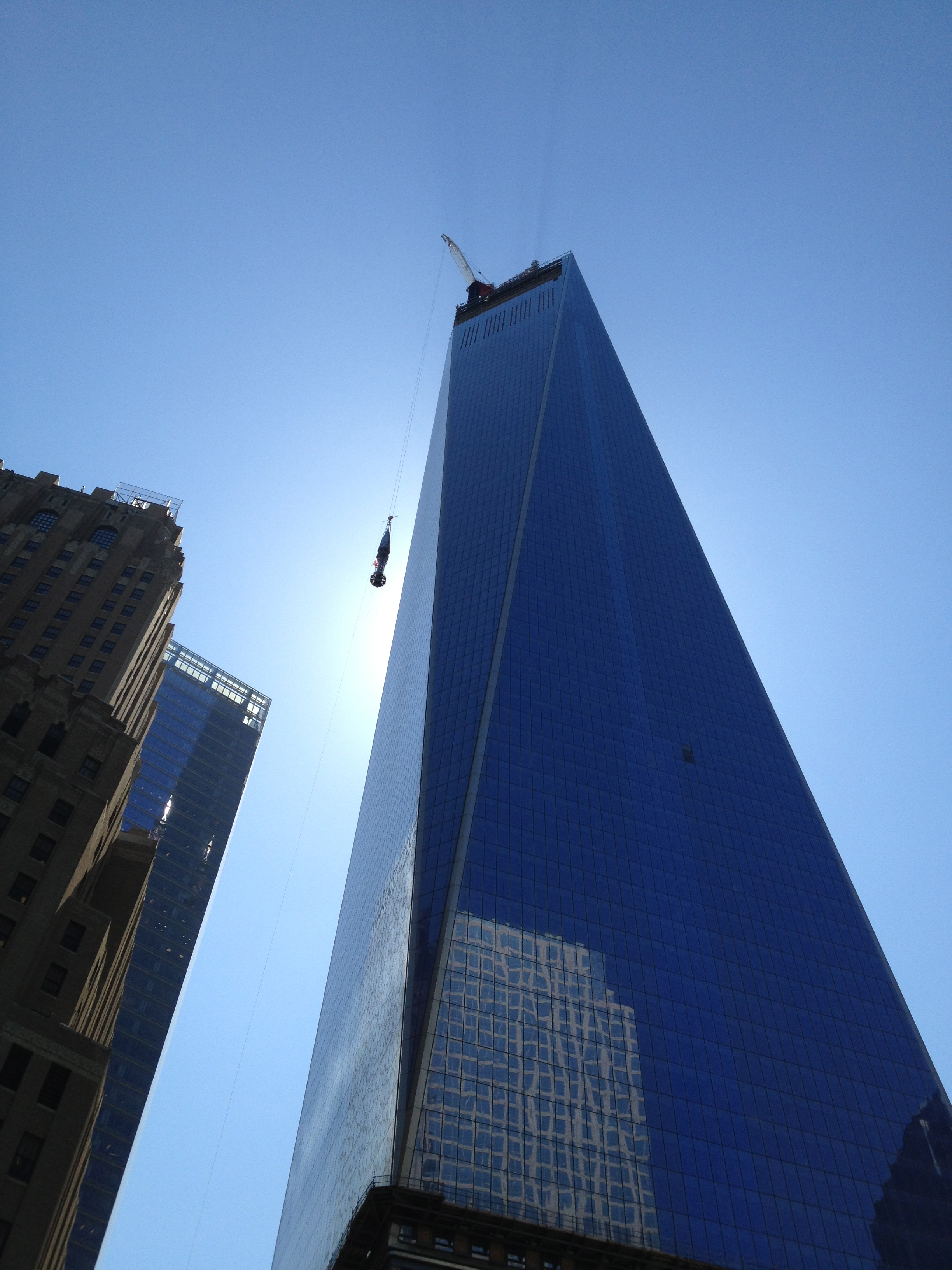 We watched the spire travel to the top of the building.