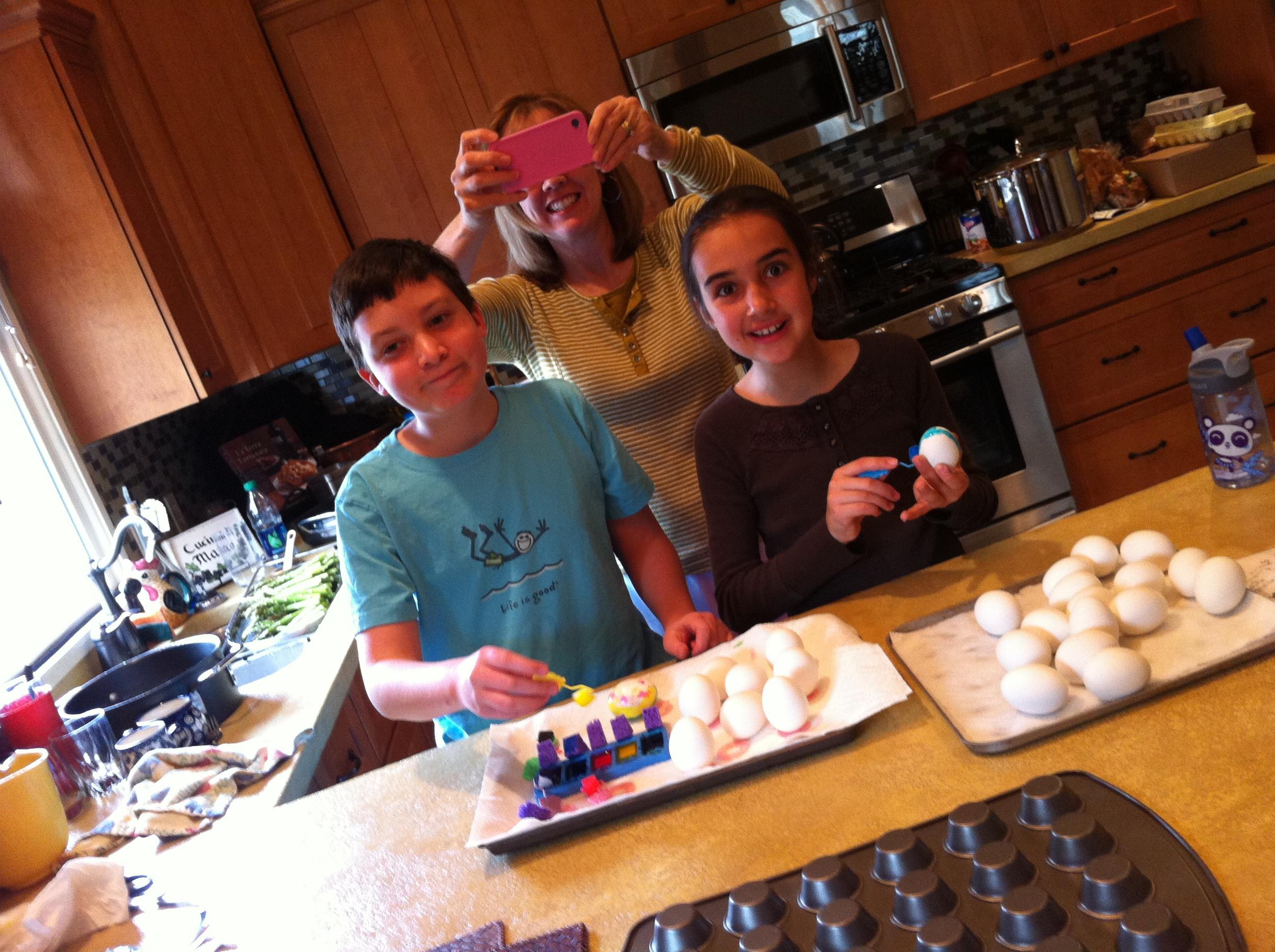 Jonathan and Zoe painting eggs.