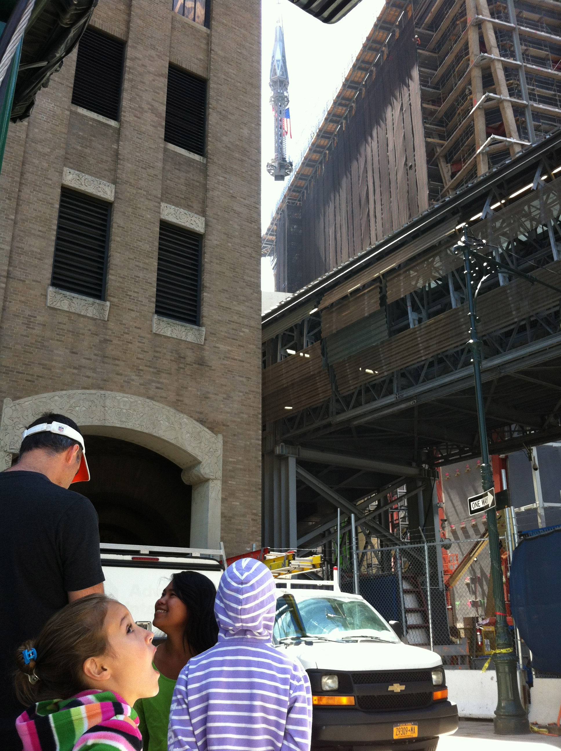 Watching the spire travel to the top of the WTC.