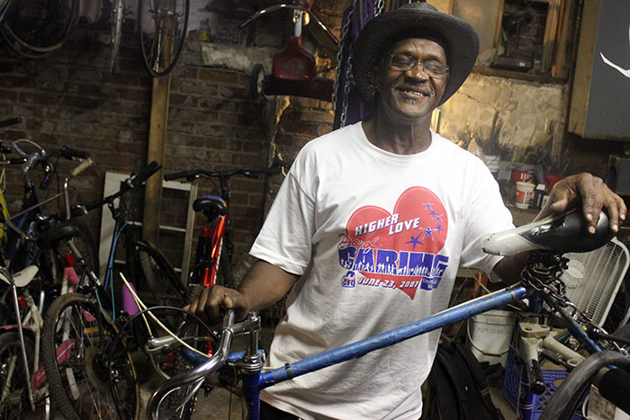 archie with his bike in the 816 shop. we worked together for entirely too long to switch out both of his brake cables.
