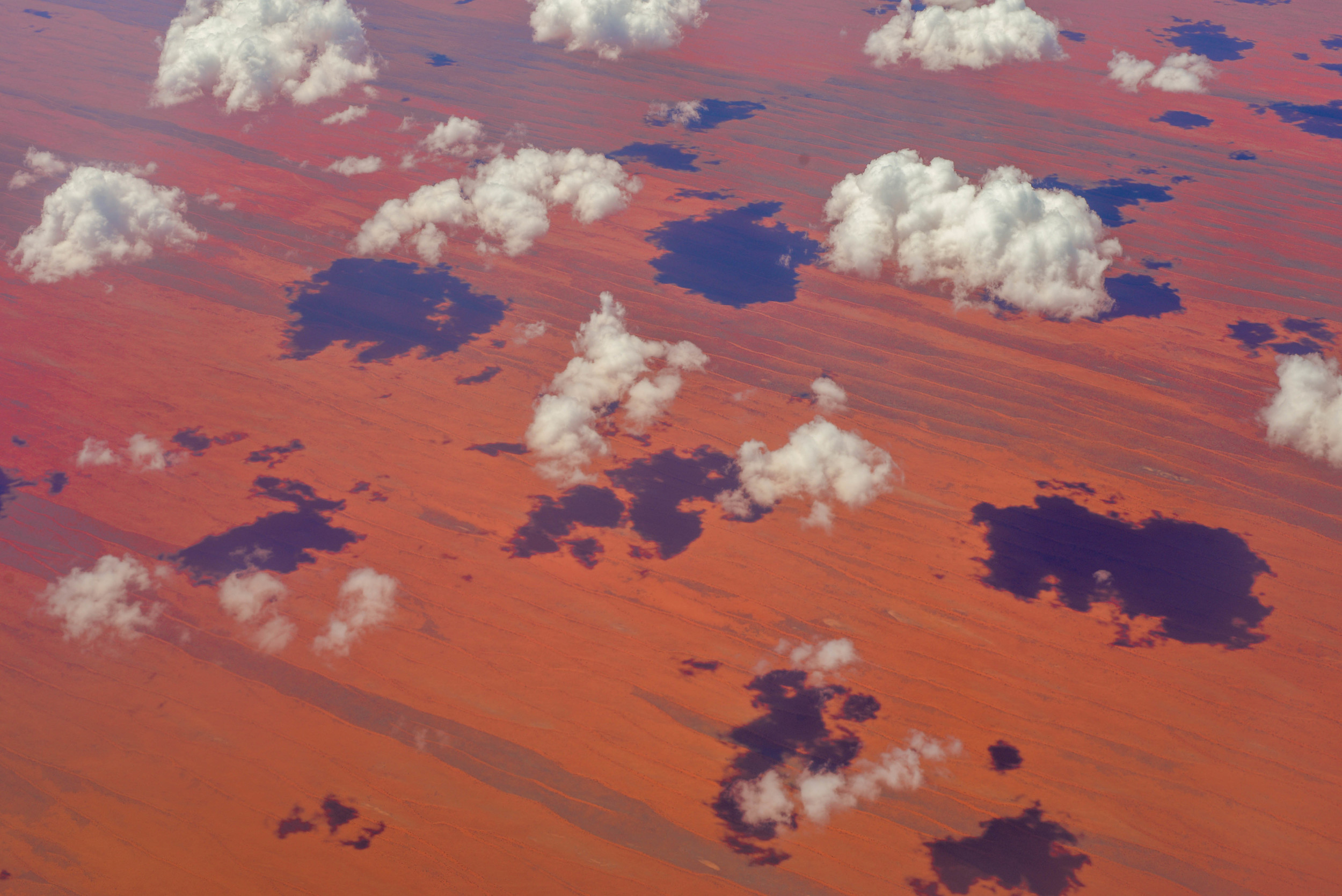 Flying over red desert in the middle of Australia