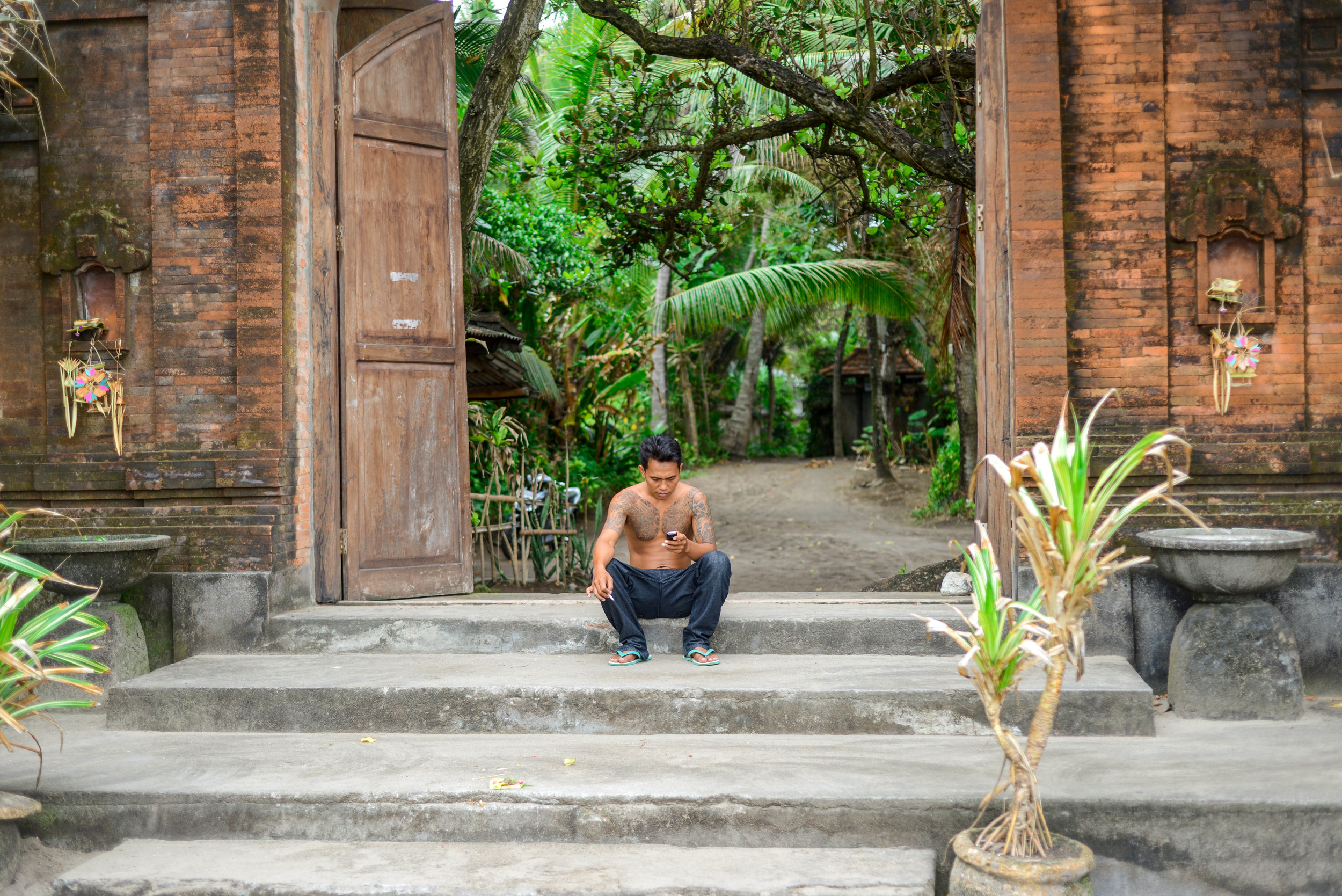 A local at the entry of a temple in Seminyak.