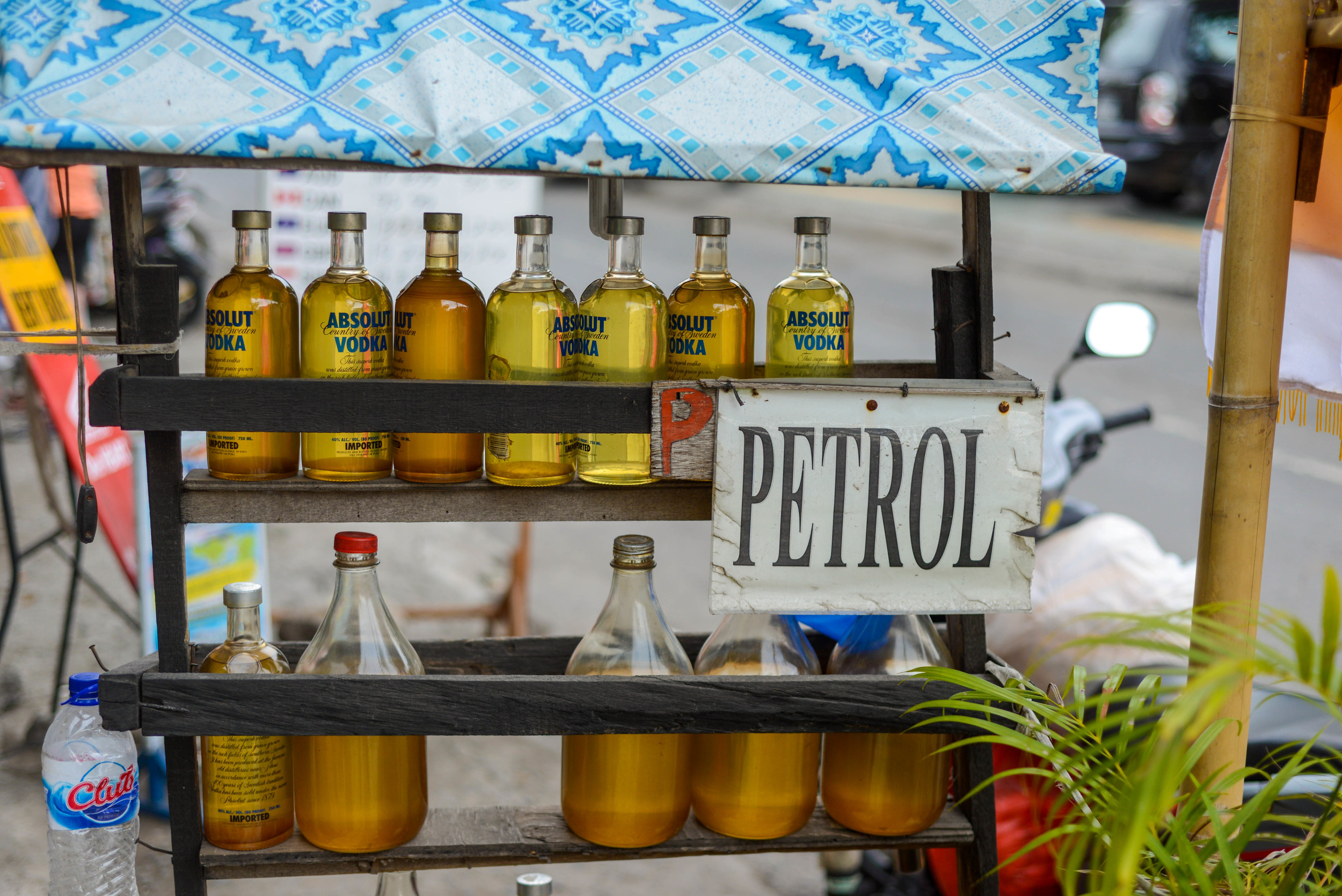 Petrol sold in Vodka bottles.