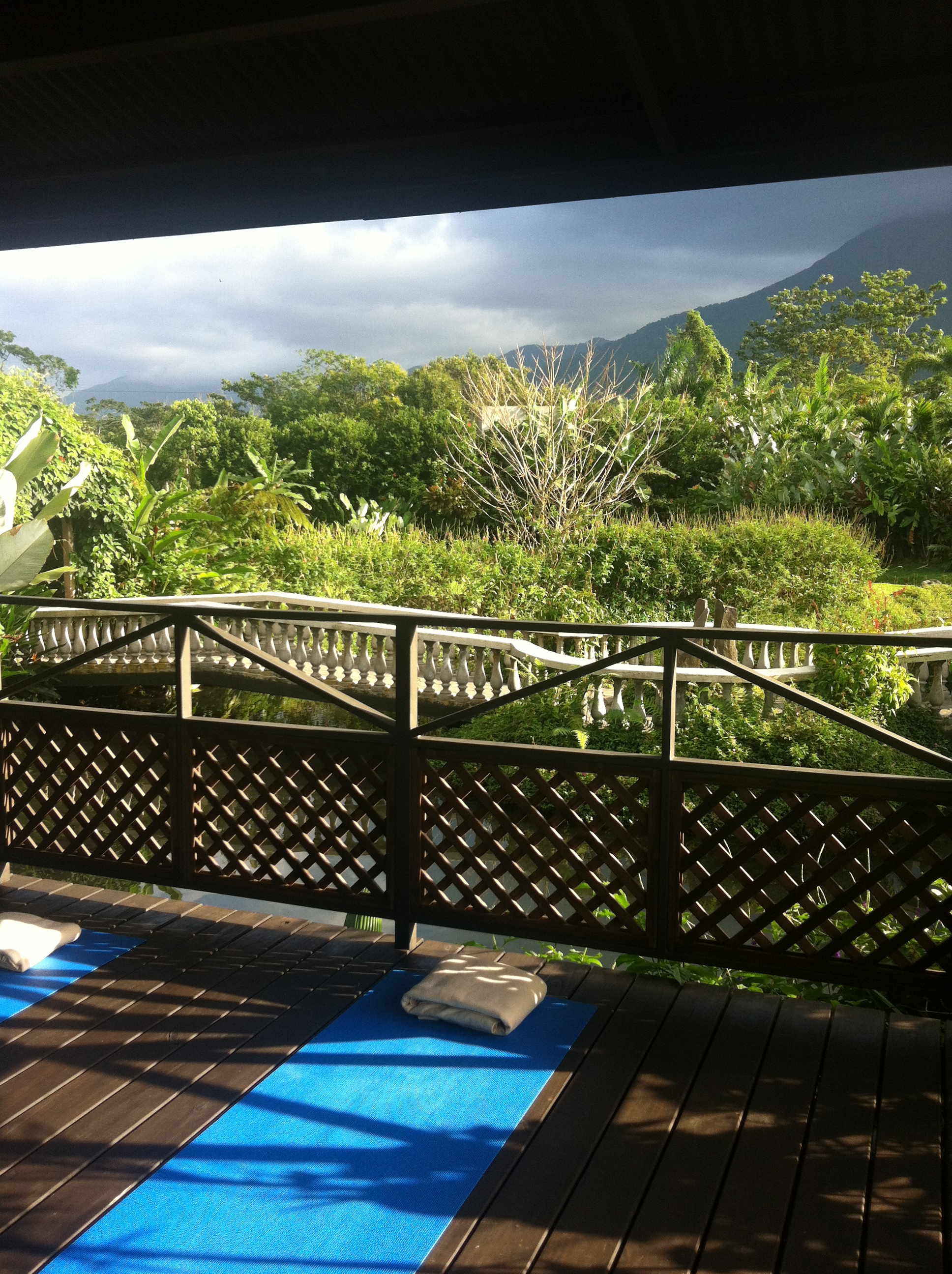 """Thank you for the inspirational photo and words@mrmlfr """"This was taken at a spa with one of the best views of Arenal Volcano in Costa Rica. Meditation and yoga help me keep an open heart, mind and spirit. I was lucky enough to find this spot for some morning stretches surrounded by the most perfectly quiet and still view""""."""