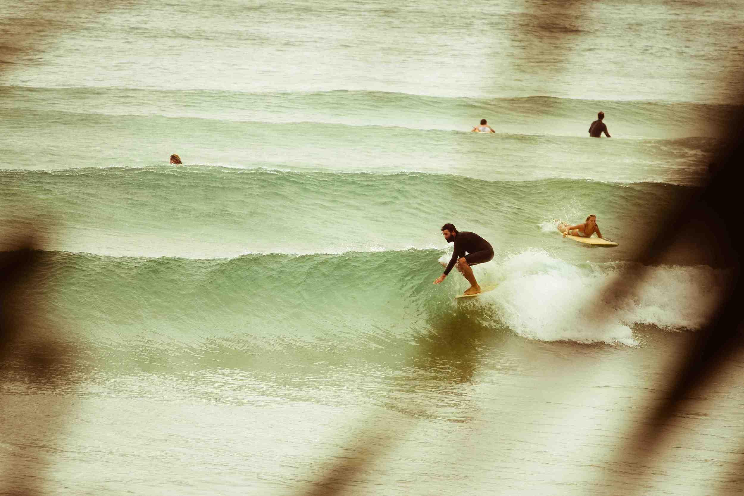 Tim enjoying the ocean, surfing at Wategos, Byron Bay.