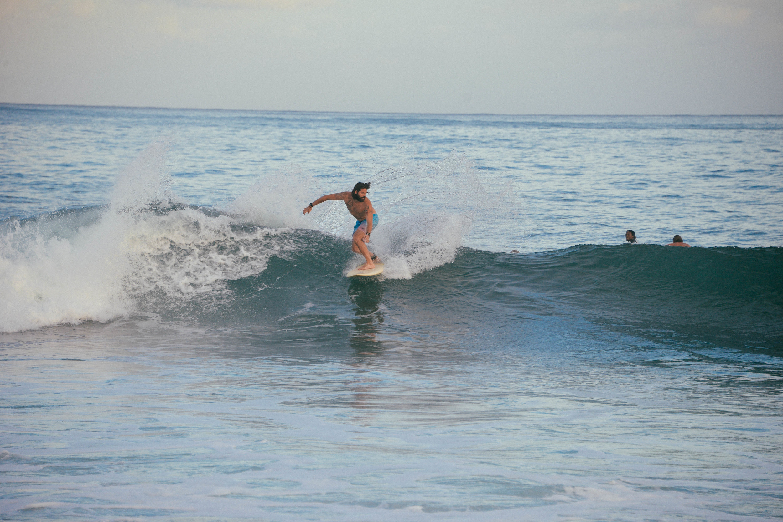 Jonny surfing Rocky Point on the North Shore, Oahu.